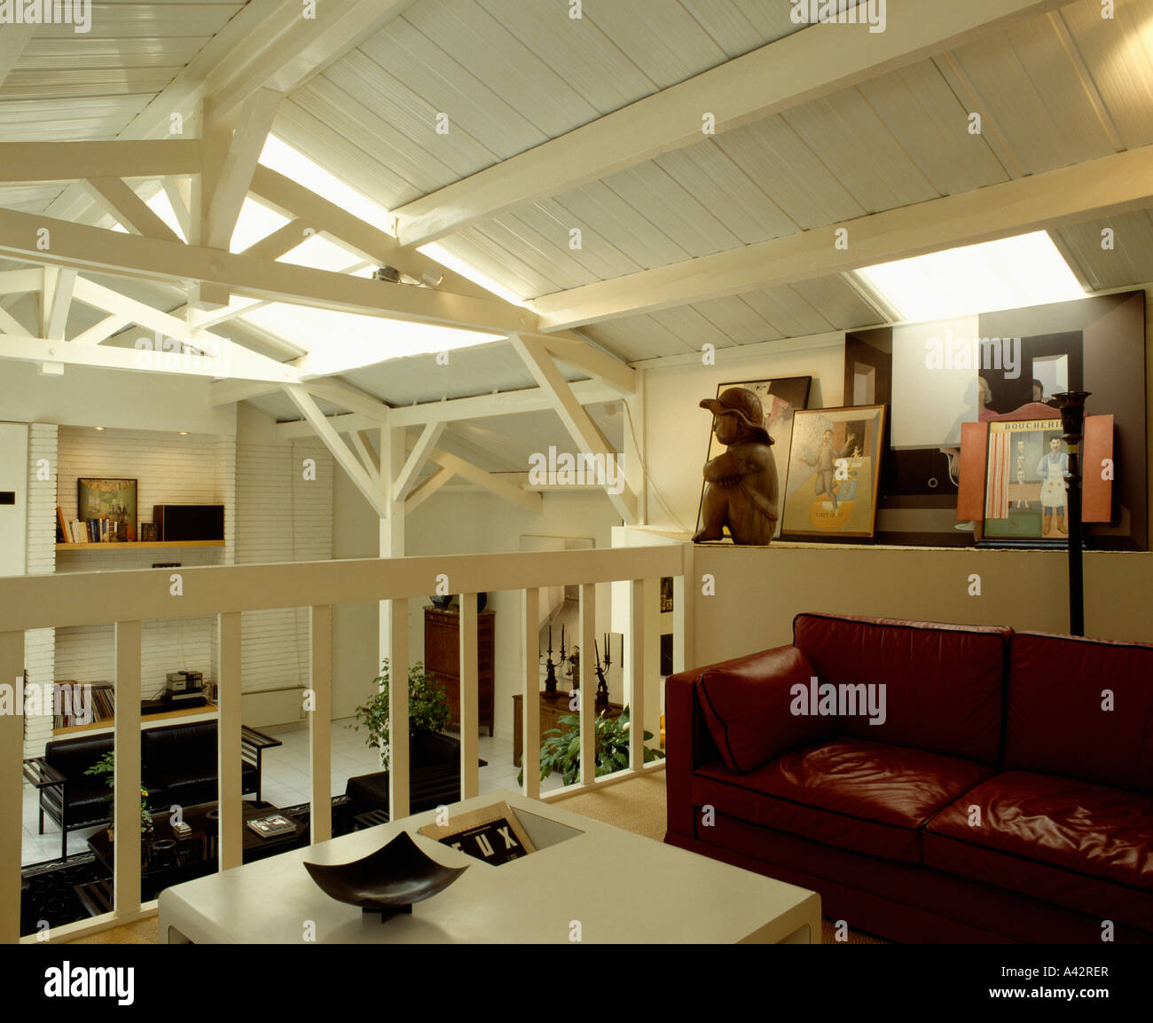 Mezzanine Loft Conversion brown leather sofa on mezzanine in loft conversion apartment with