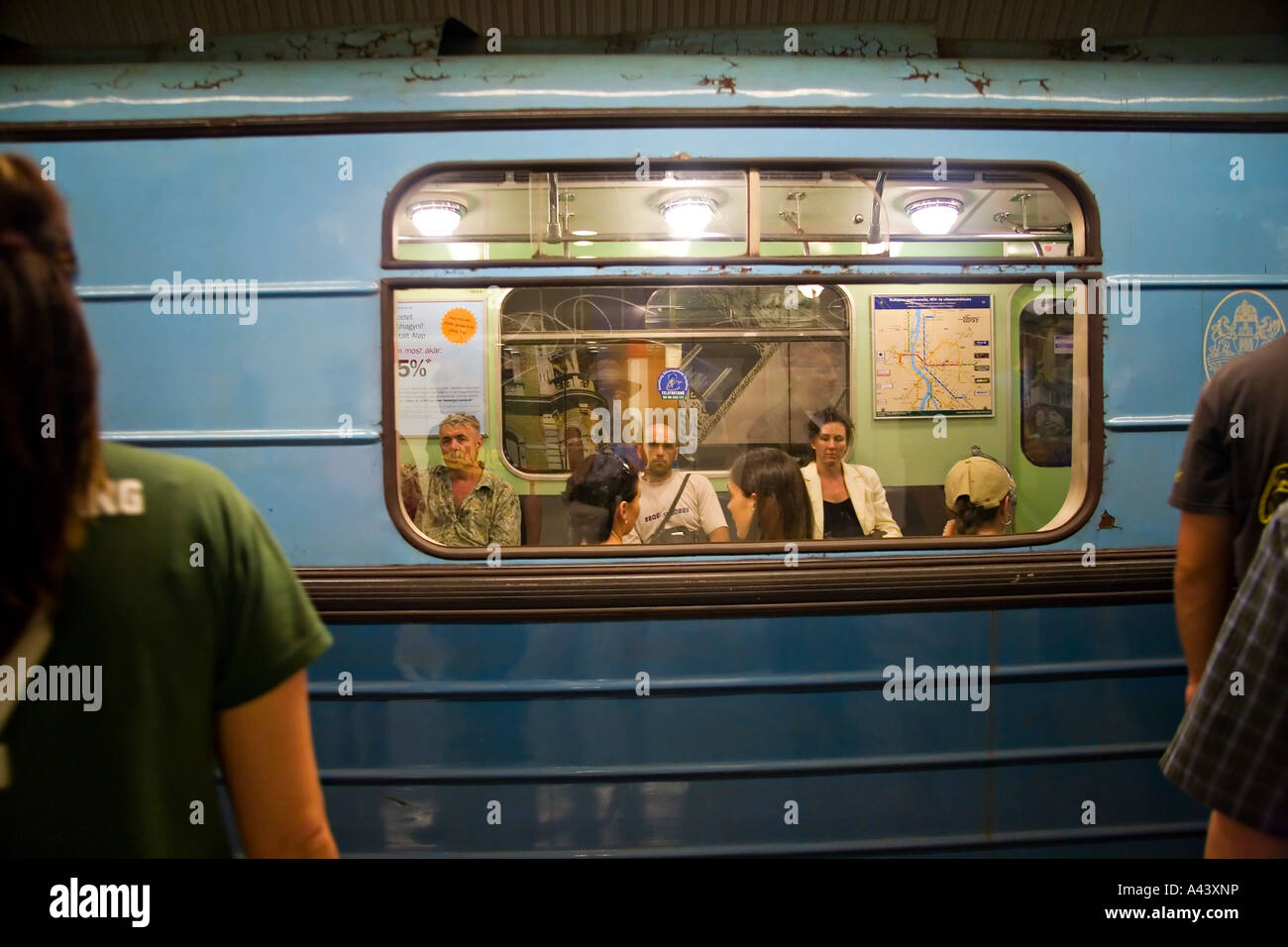 Sit In Window hungary budapest people sit in train car in subway station people