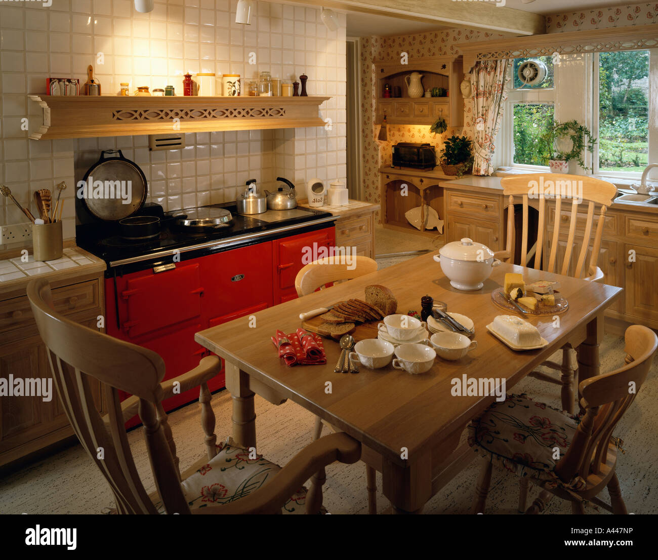 Country Kitchen Dining Table Red Aga Oven In Traditional Country Kitchen With Wooden Dining