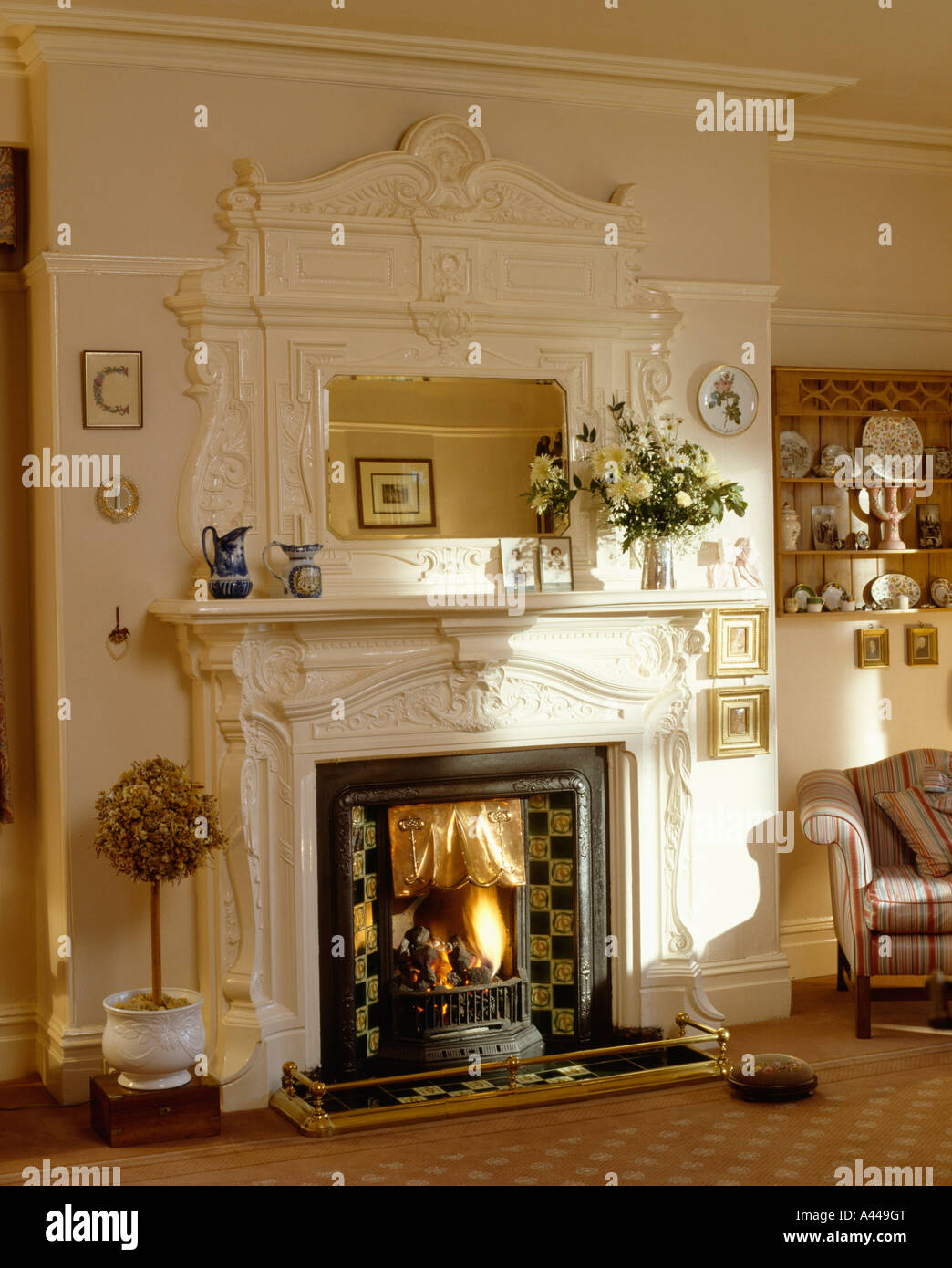 Close Up Of Cream Edwardian Fireplace And Overmantel Mirror In Traditional Sittingroom