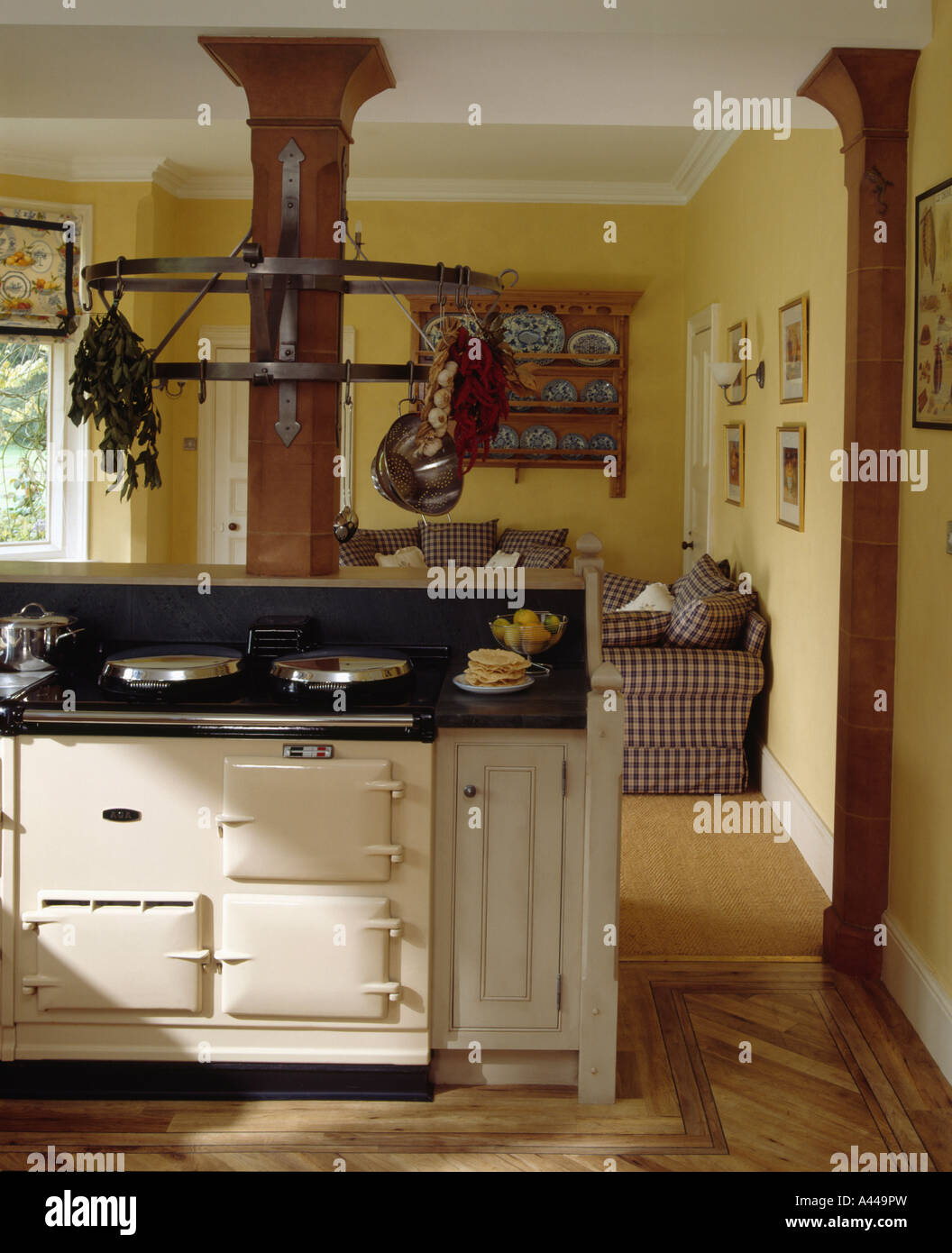 Aga Kitchen Appliances Cream Aga Cooker In Large Openplan Country Kitchen With Sofa Stock