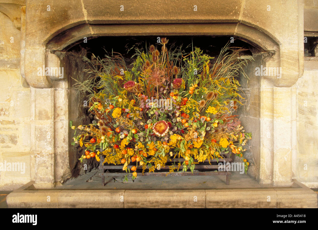 Flower Arrangement In Fireplace Stock Photo Royalty Free