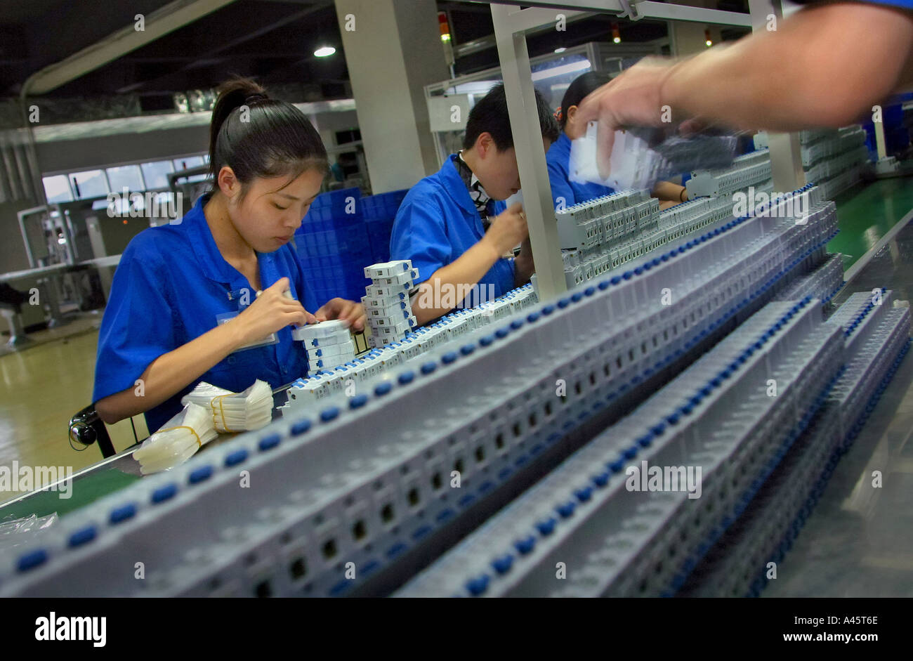 female workers on the assembly line at the chint group low voltage female workers on the assembly line at the chint group low voltage electrical appliance factory in