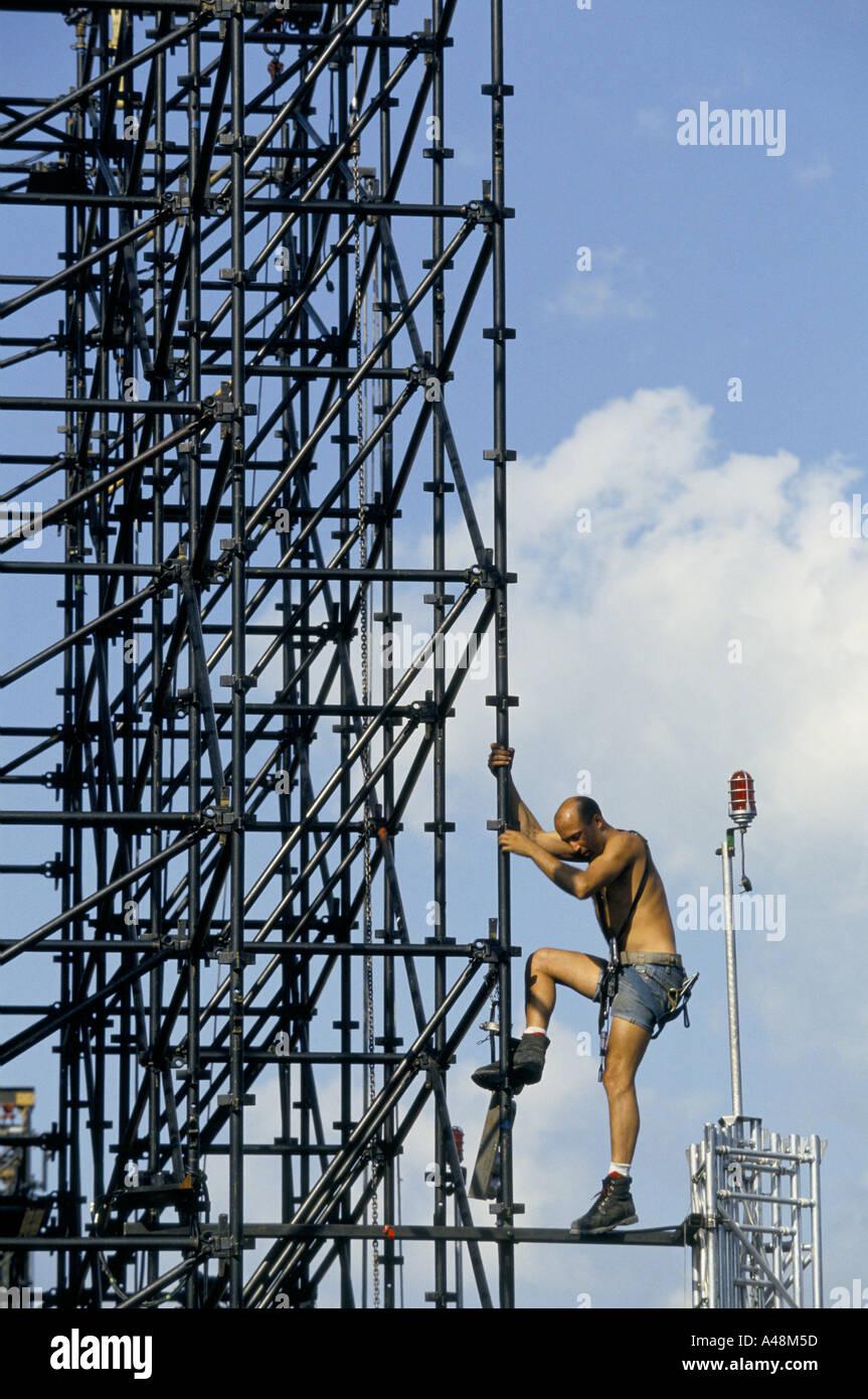 a rigger working on scaffolding setting up the stage for a concert a rigger working on scaffolding setting up the stage for a concert by rock band u2 geneva switzerland