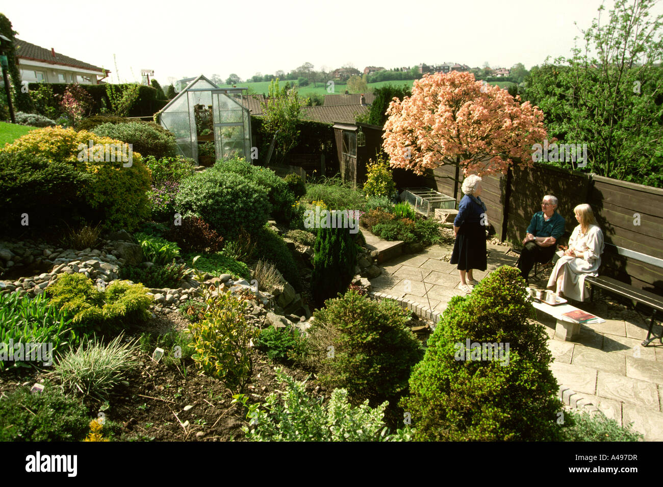 Gardens easy to maintain sloping garden stock photo for Easy gardens to maintain