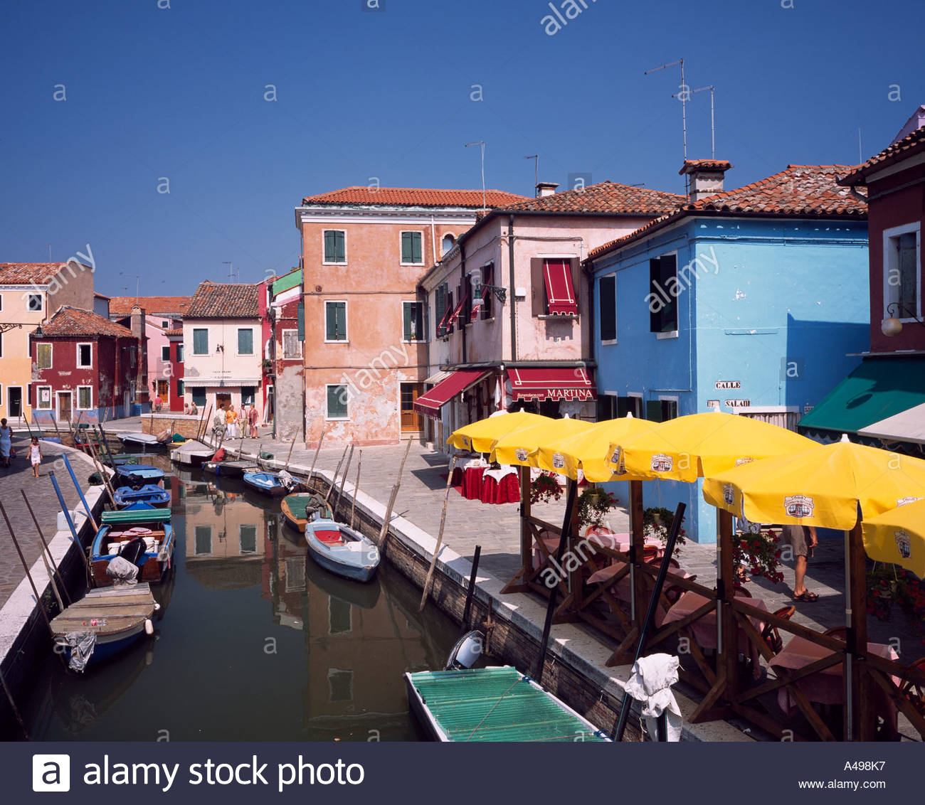 Colorful burano italy burano tourism - Stock Photo Venice Burano Island Colorful Row Of Houses Near Italy Blue Sky River Ship Rows Of Houses