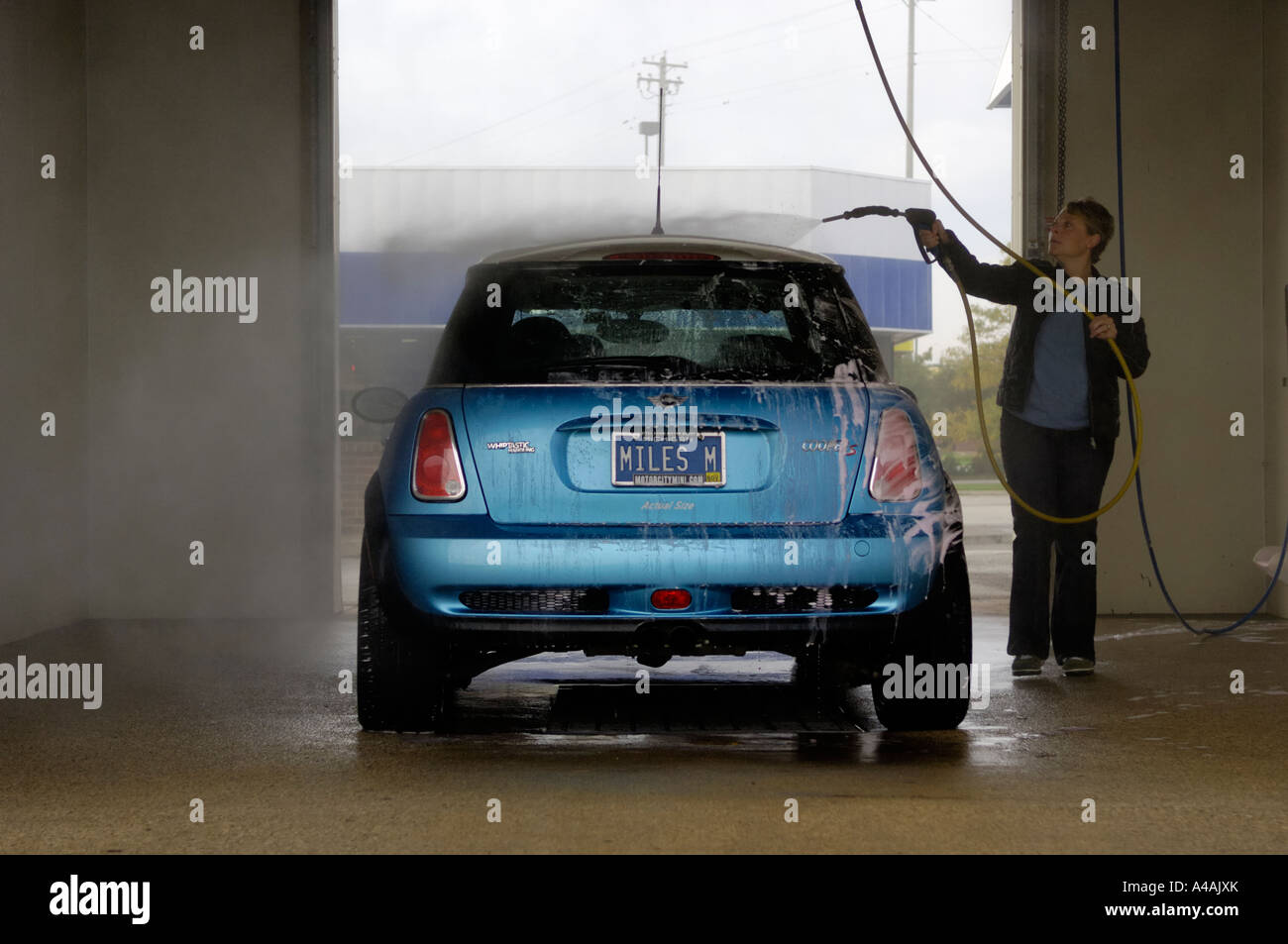Self serve car wash stock photos self serve car wash stock woman washing a mini cooper s at a do it yourself car wash stock image solutioingenieria Image collections