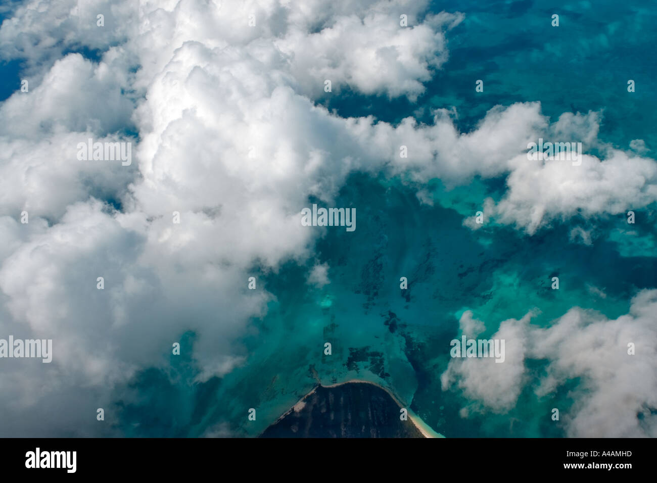 Aerial view looking down through clouds at the tip of a ...