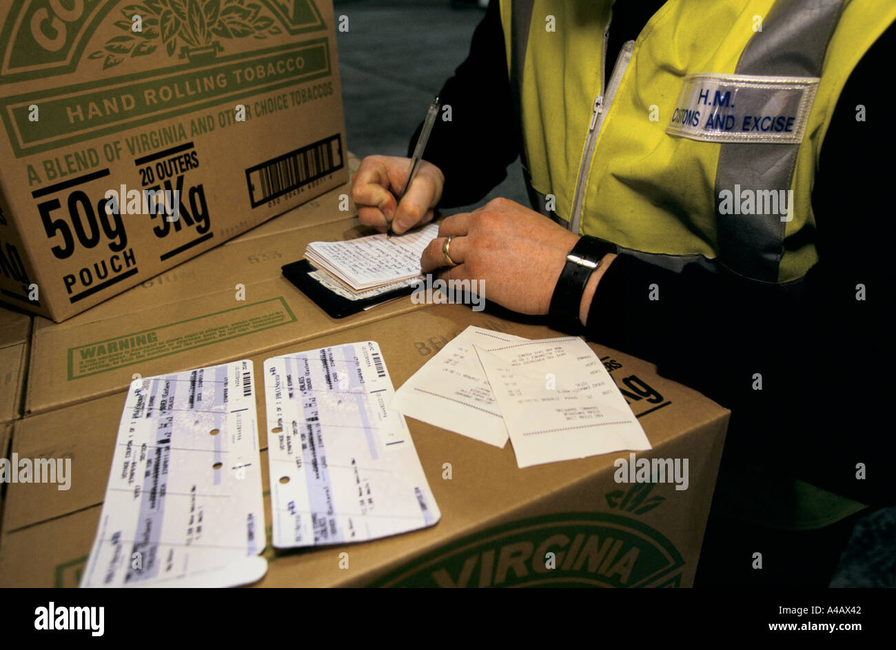 customs officer stock photos customs officer stock images alamy a customs excise officer at dover port on england s south coast catalogues goods being confiscated