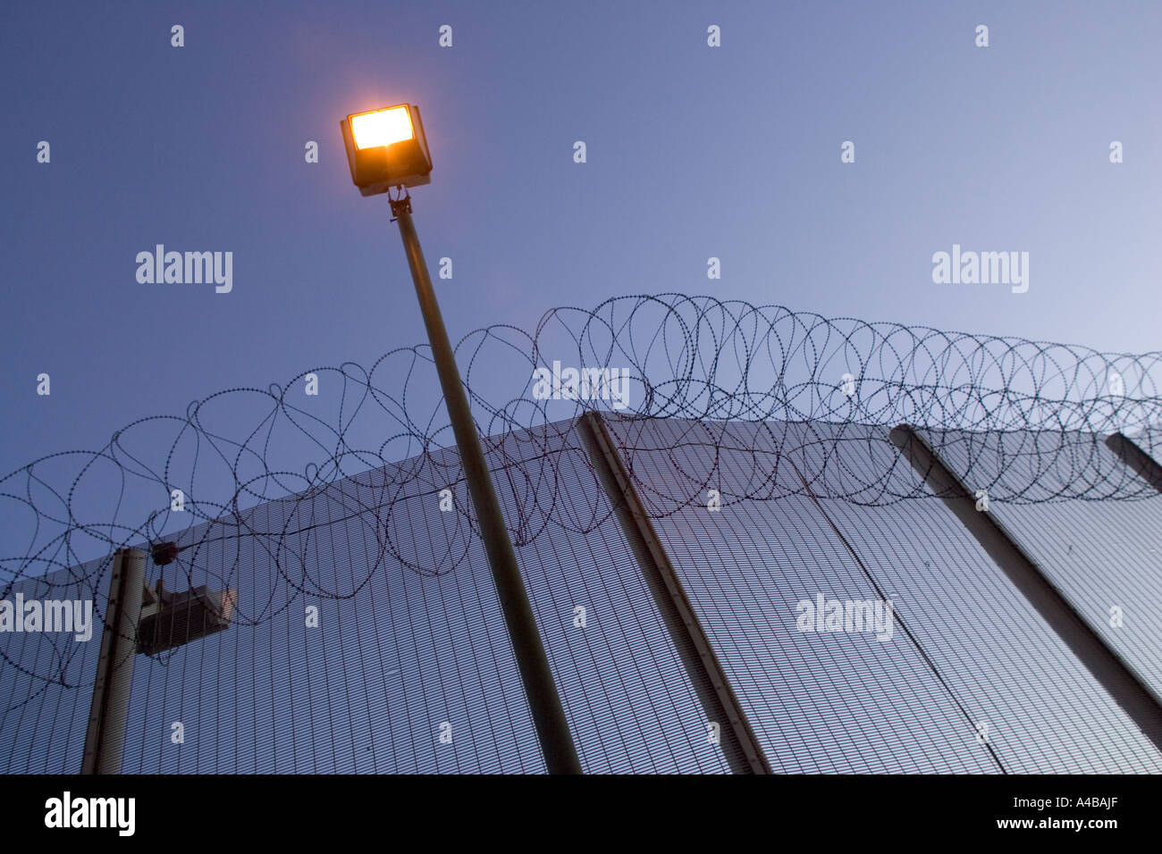 Razor wire and security lighting wormwood scrubs prison london razor wire and security lighting wormwood scrubs prison london uk mozeypictures Gallery