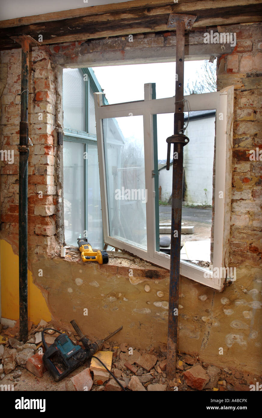 Acrow Props Uk : Acrow props holding a ceiling and joists in order to