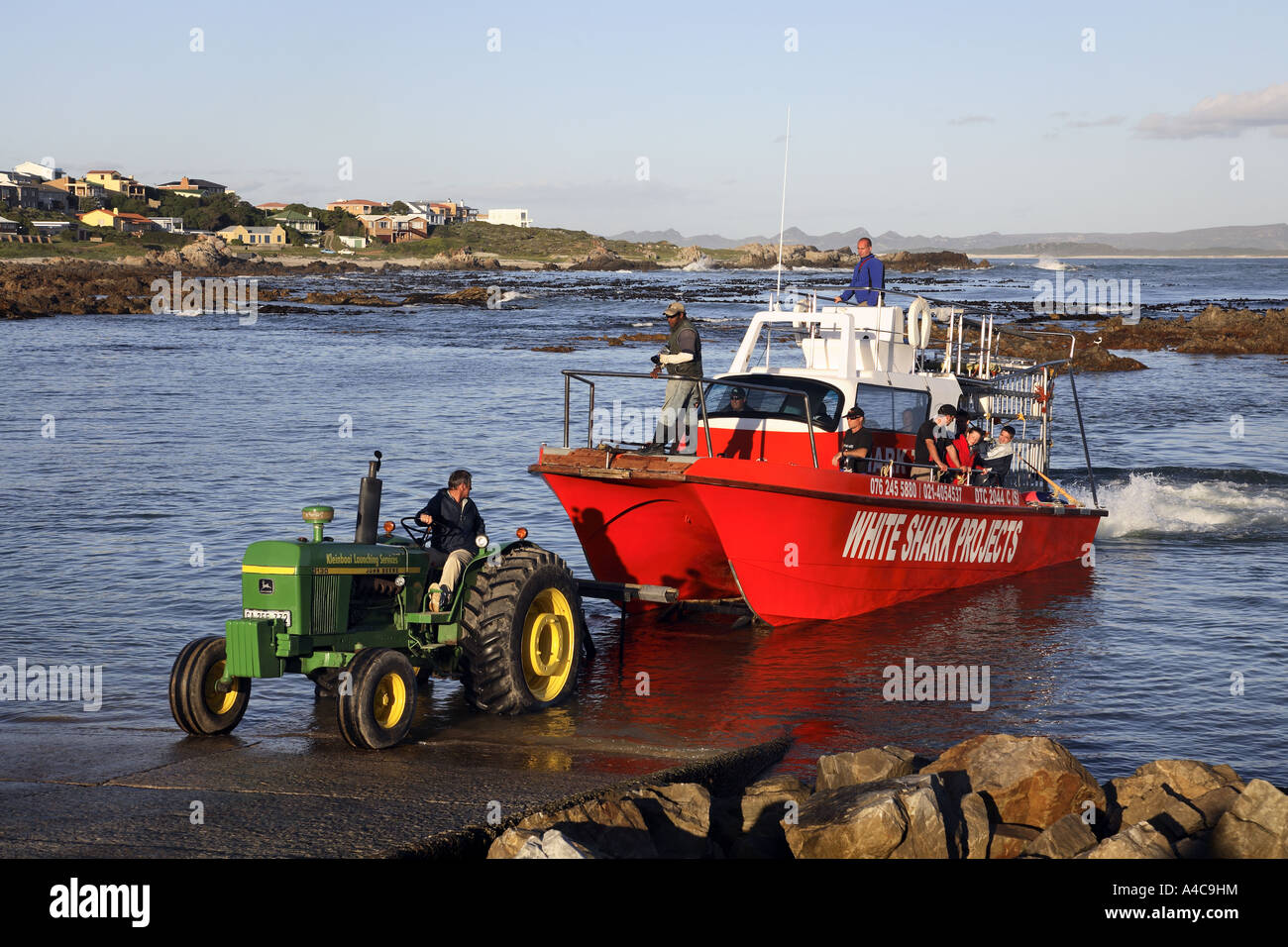 Tractor Pull Boats : Tractor towing boat on quay stock photo royalty free
