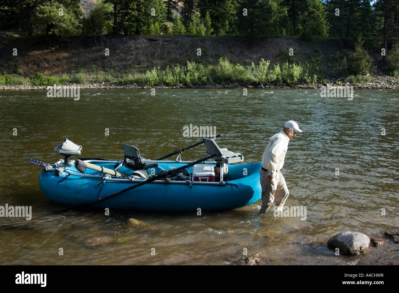 A montana fly fishing guide with his raft on the blackfoot for Fly fishing raft