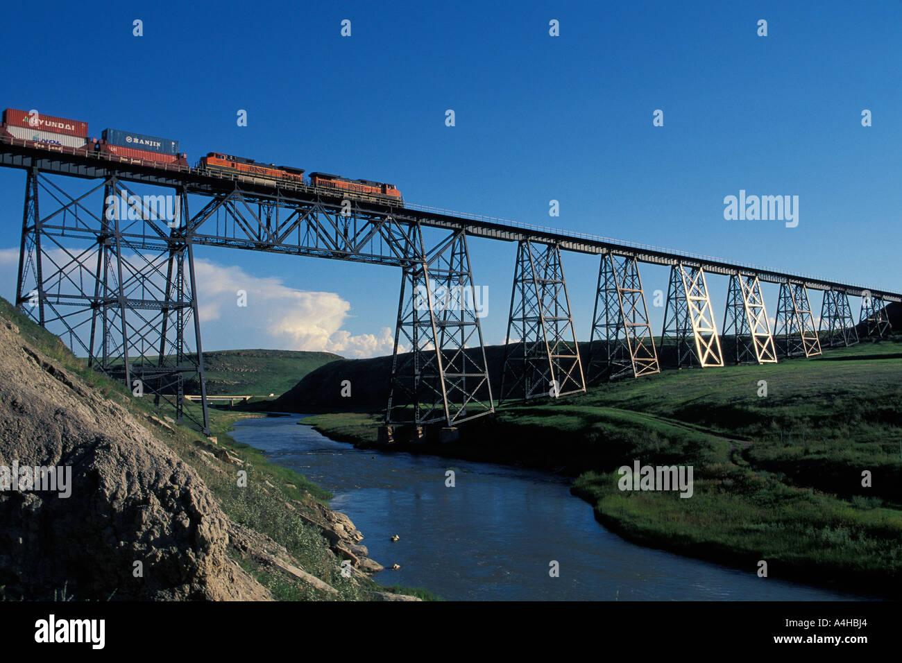 Freight train crossing railroad trestle over Cutbank Creek Cutbank
