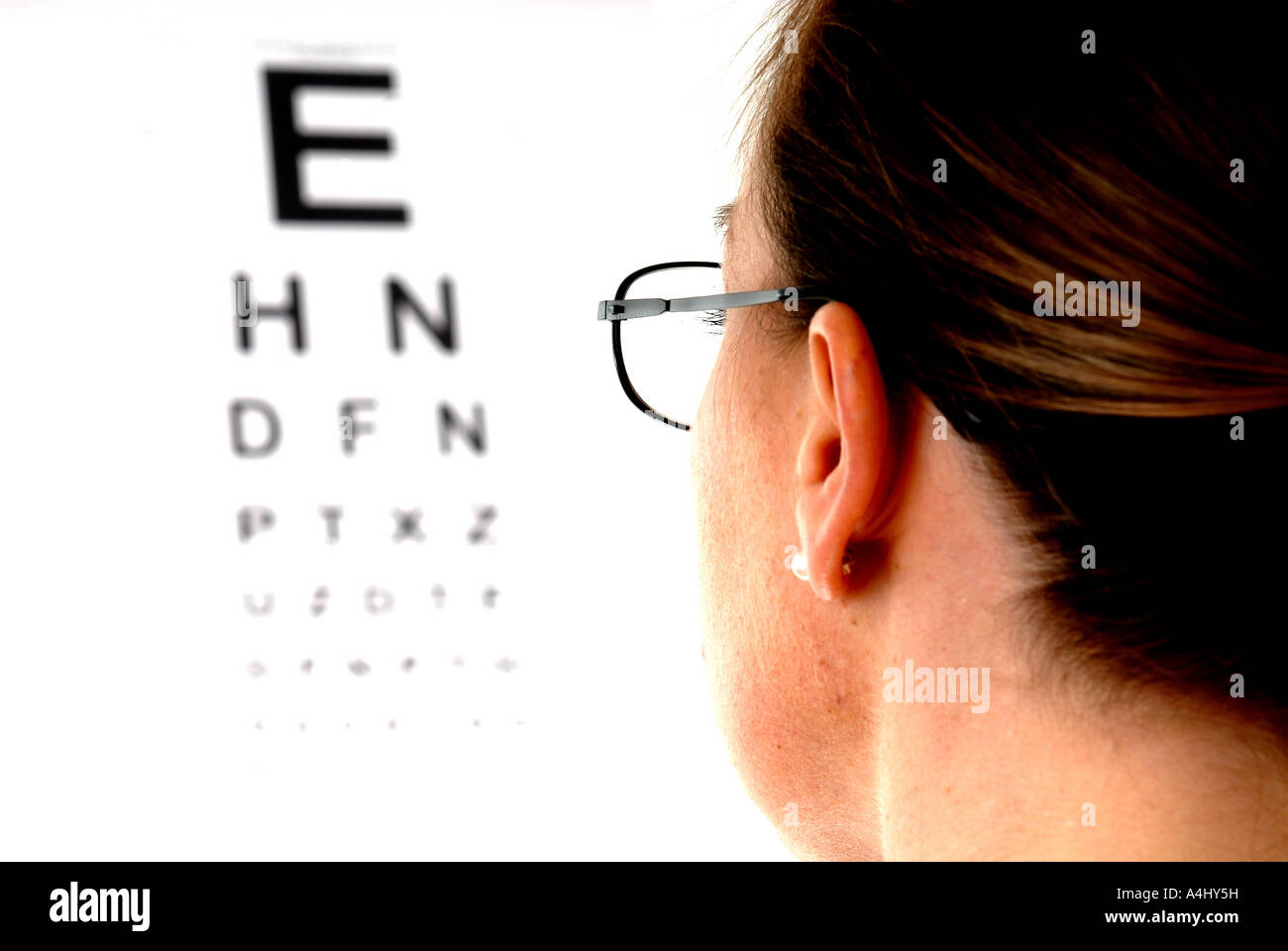 Woman reading eye test chart stock photo royalty free image woman reading eye test chart nvjuhfo Image collections