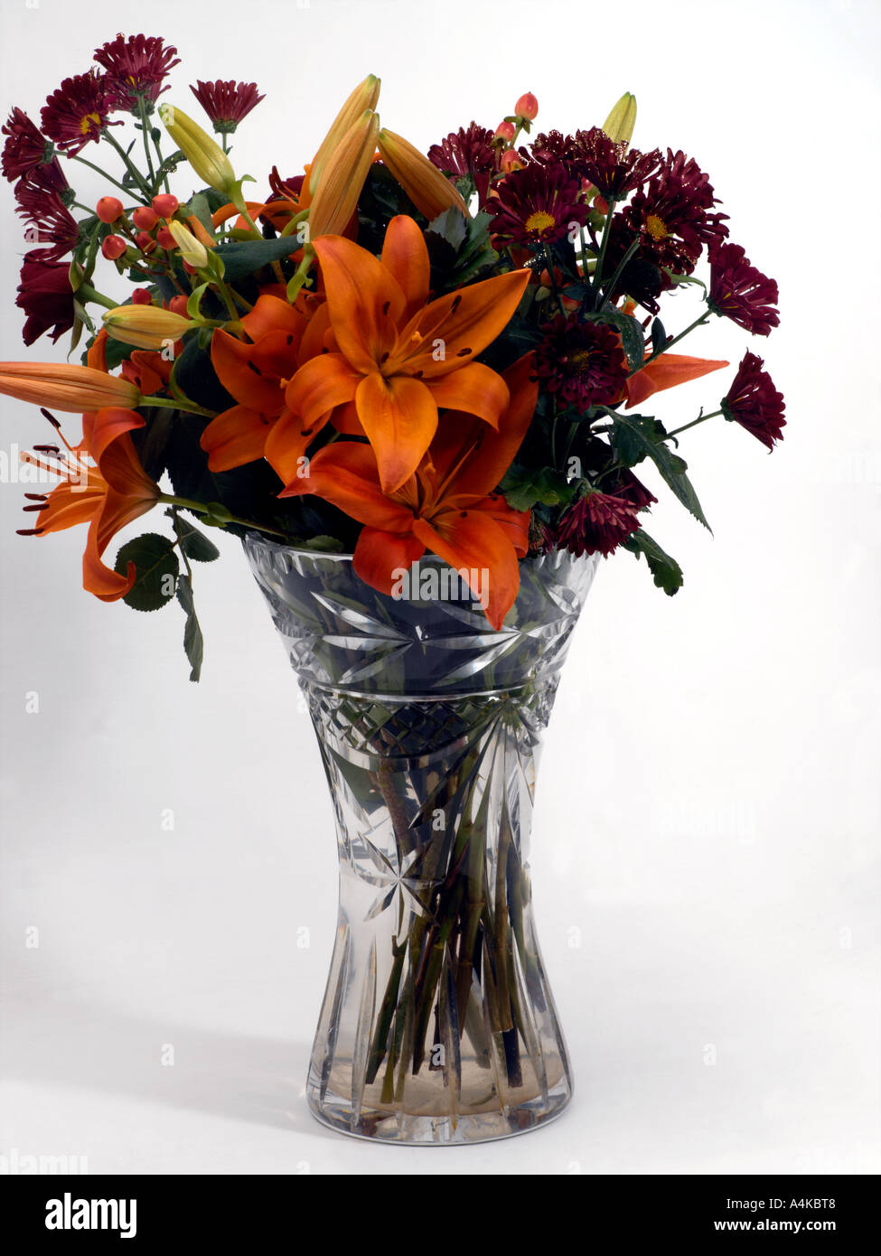 Vase of flowers orange lilies and purple daisies with glitter in vase of flowers orange lilies and purple daisies with glitter in lead crystal vase floridaeventfo Images