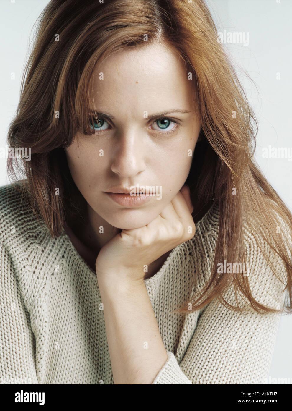 Woman glaring at camera, close-up Stock Photo, Royalty