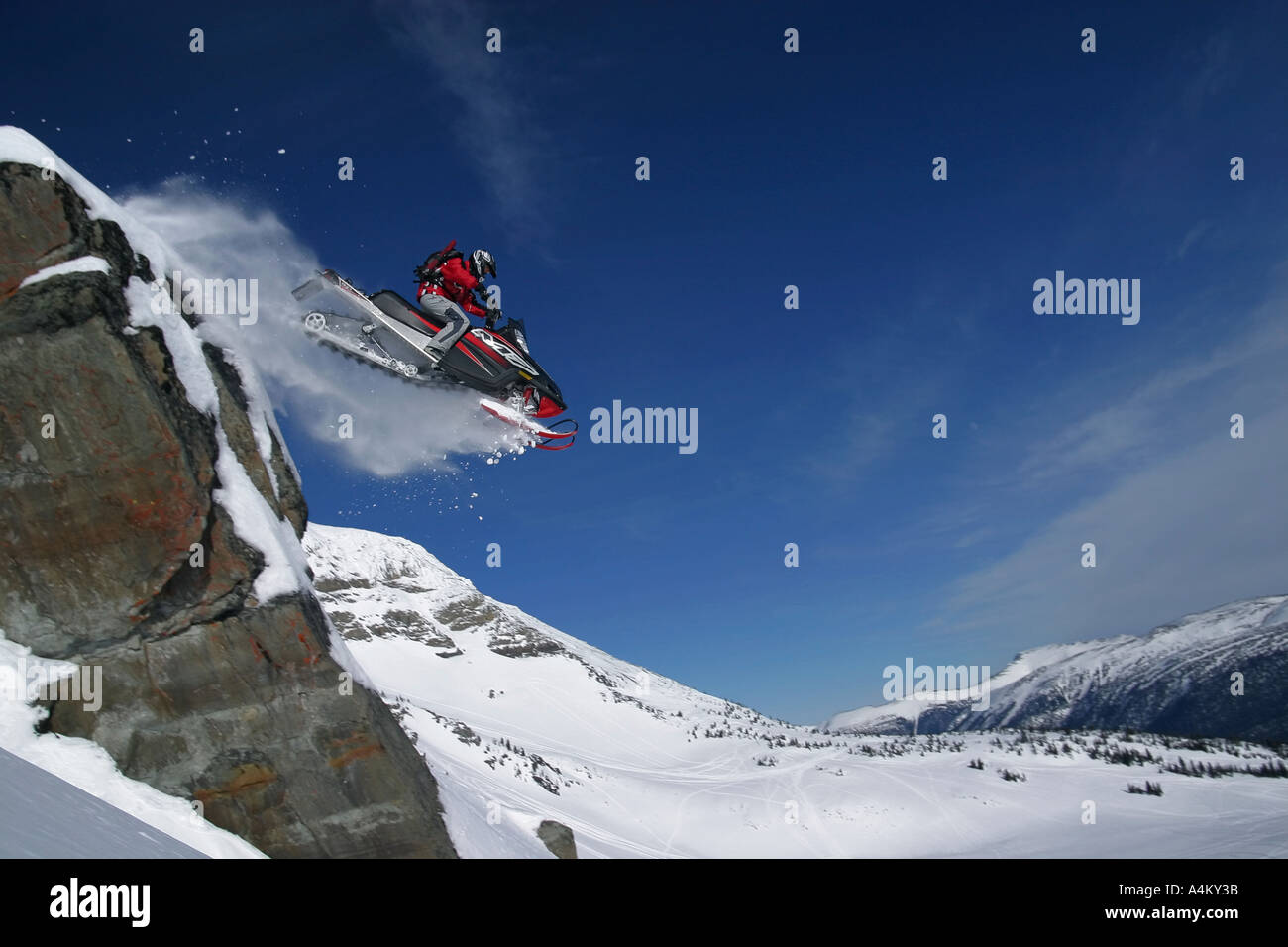 Snowmobile Jumping Extreme Snowmobiling Stock Photos Snowmobile - This is what happens when you fly a snowmobile off a cliff