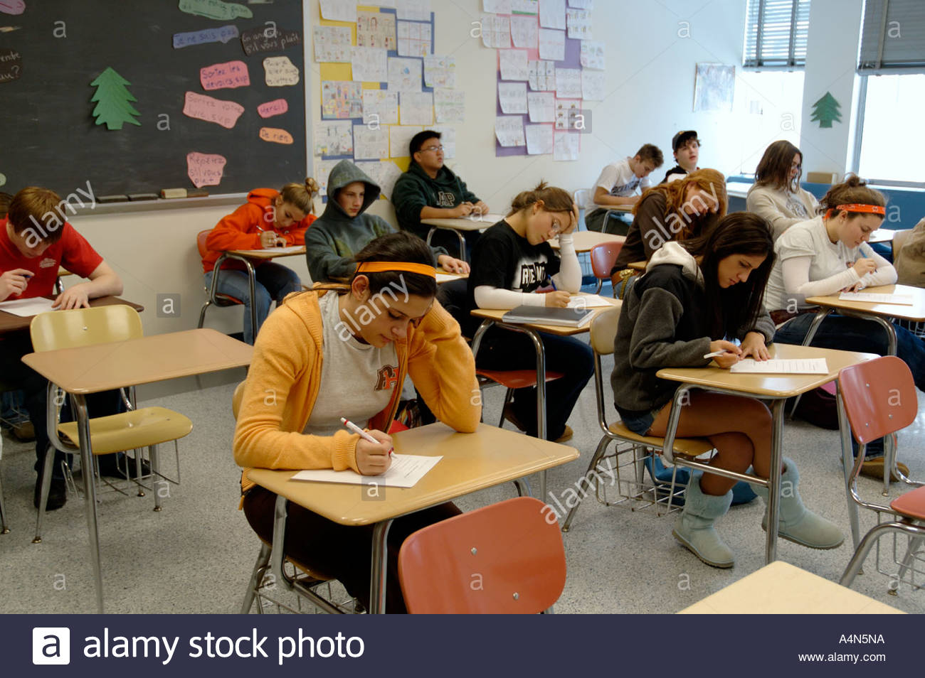high school secondary students at desks taking test stock