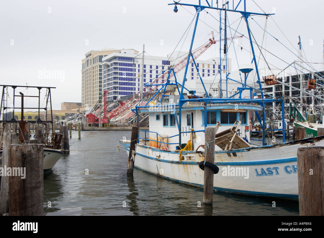 Shrimp boats in fishing harbor next to destroyed casino in for Biloxi fishing charters
