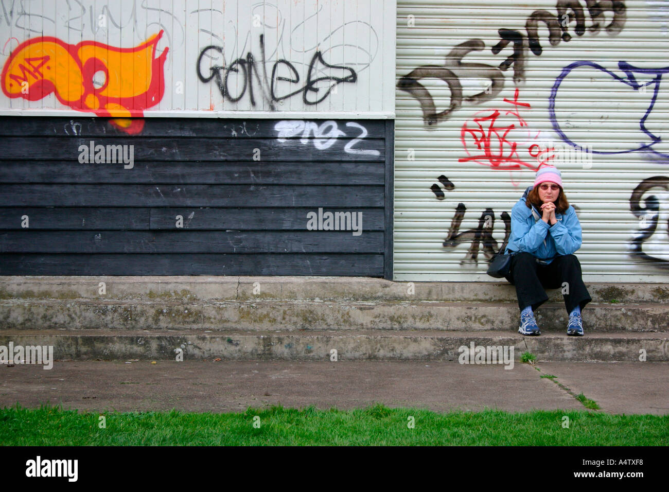 Graffiti wall cambridge - Stock Photo Woman Sitting In Front Of Urban Graffiti Cambridge England