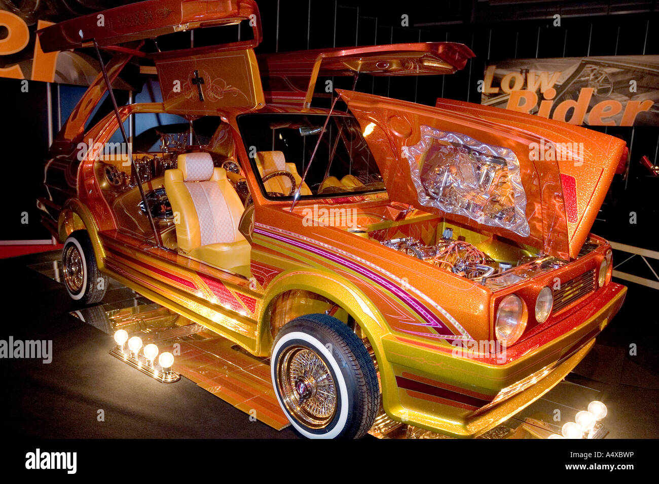 gilded low rider show car at the essen motor show nrw germany stock photo royalty free image. Black Bedroom Furniture Sets. Home Design Ideas
