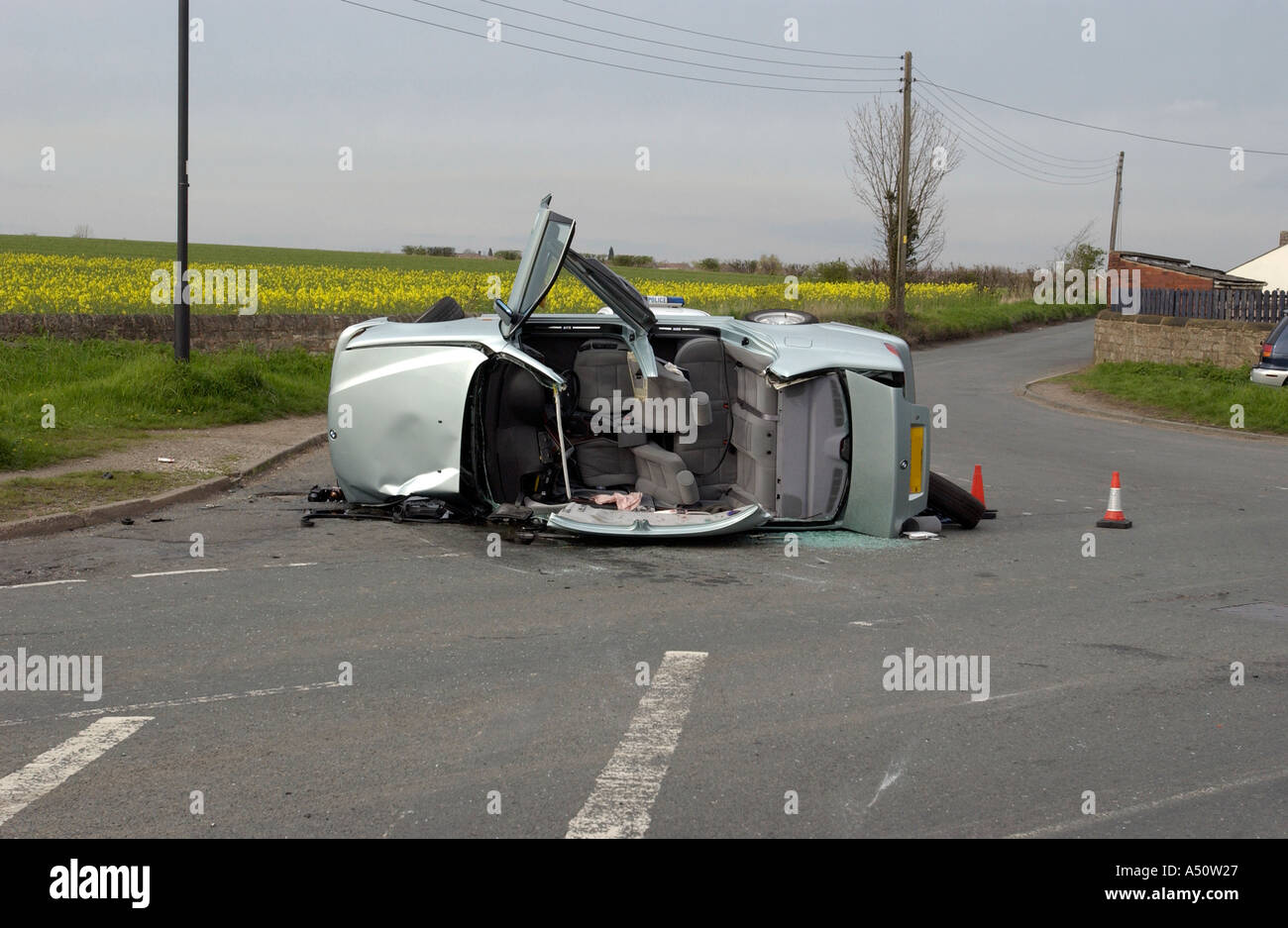 Bmw Car On Its Side With Its Roof Torn Off Following A Road