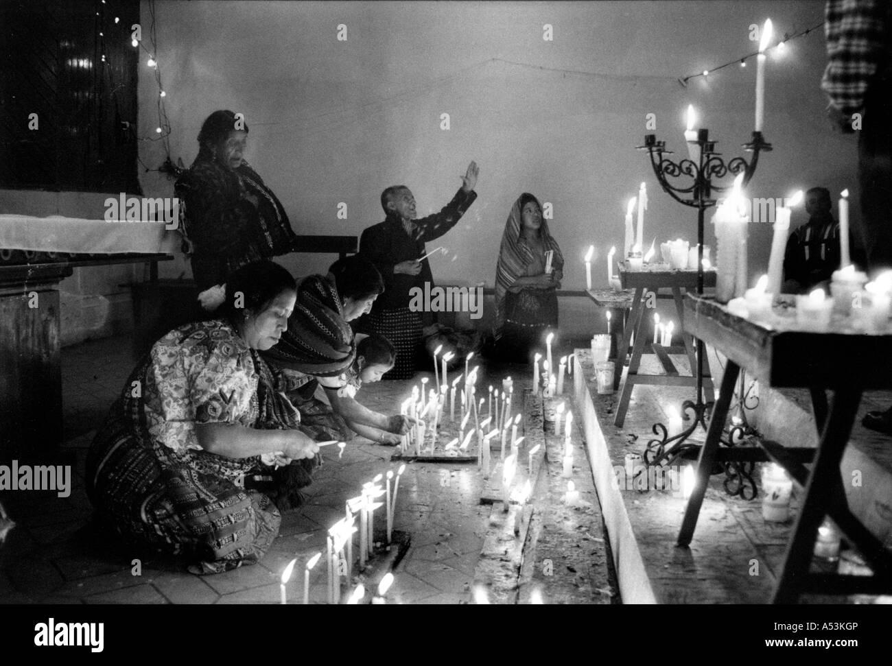 painet ha1276 063 black and white religion lighting candles alter cotholic church santa lucia utatlan guatemala alter lighting