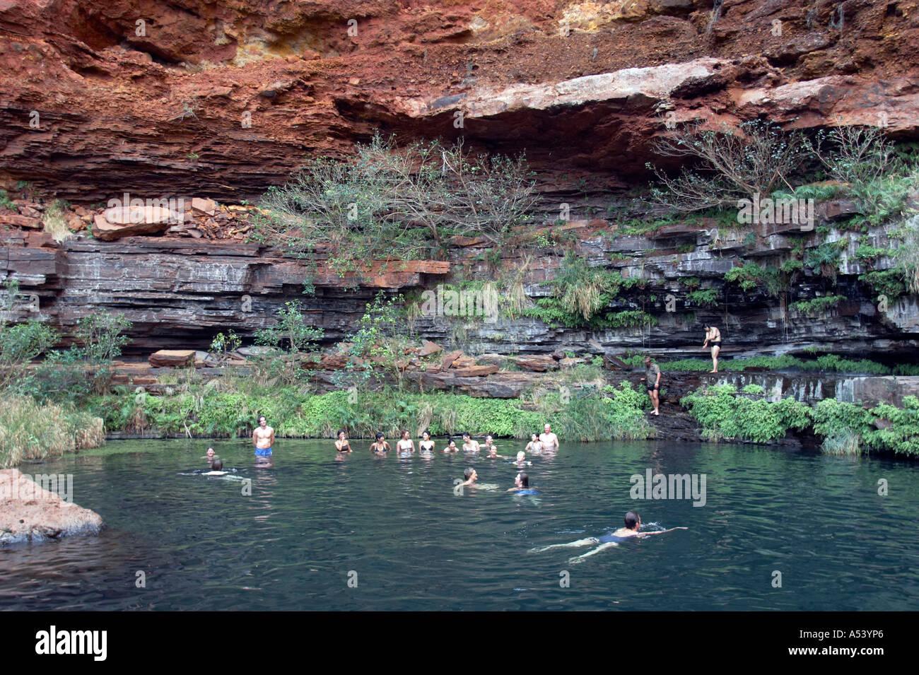 Tourists Swim In Circular Pool Dales Gorge Karijini National Park Stock Photo Royalty Free