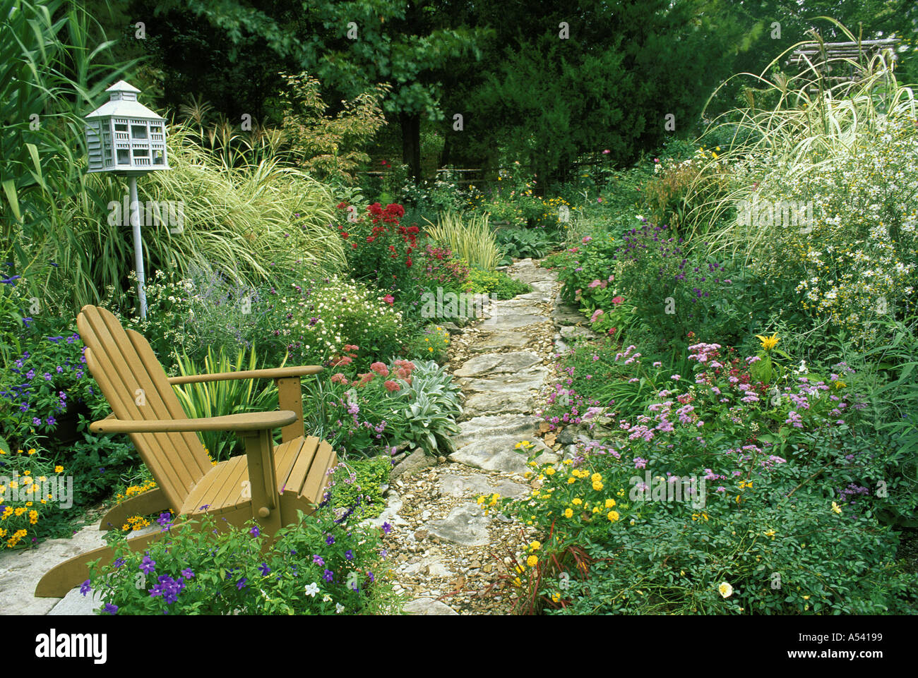 Flower Garden Path rock garden path curves through flower garden with chair and stock
