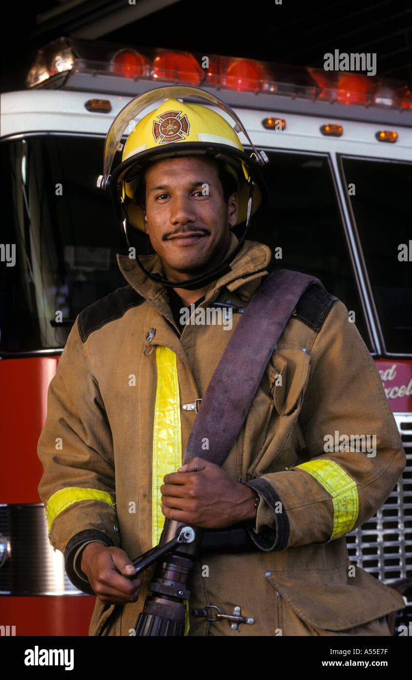portrait of male African American firefighter standing in ...
