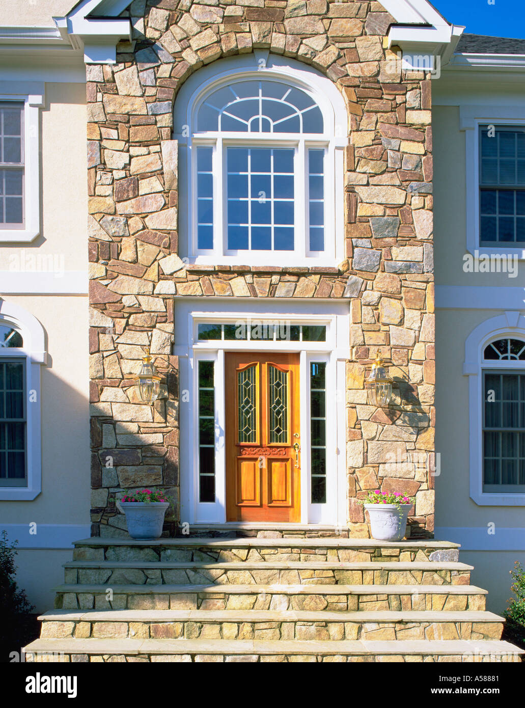 Front Entrance Of Elegant House With Stone Facade And