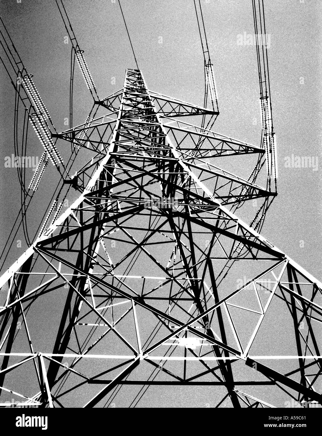 Monochrome study of steel lattice frame structure of a National Grid high  voltage electricity pylon, UK
