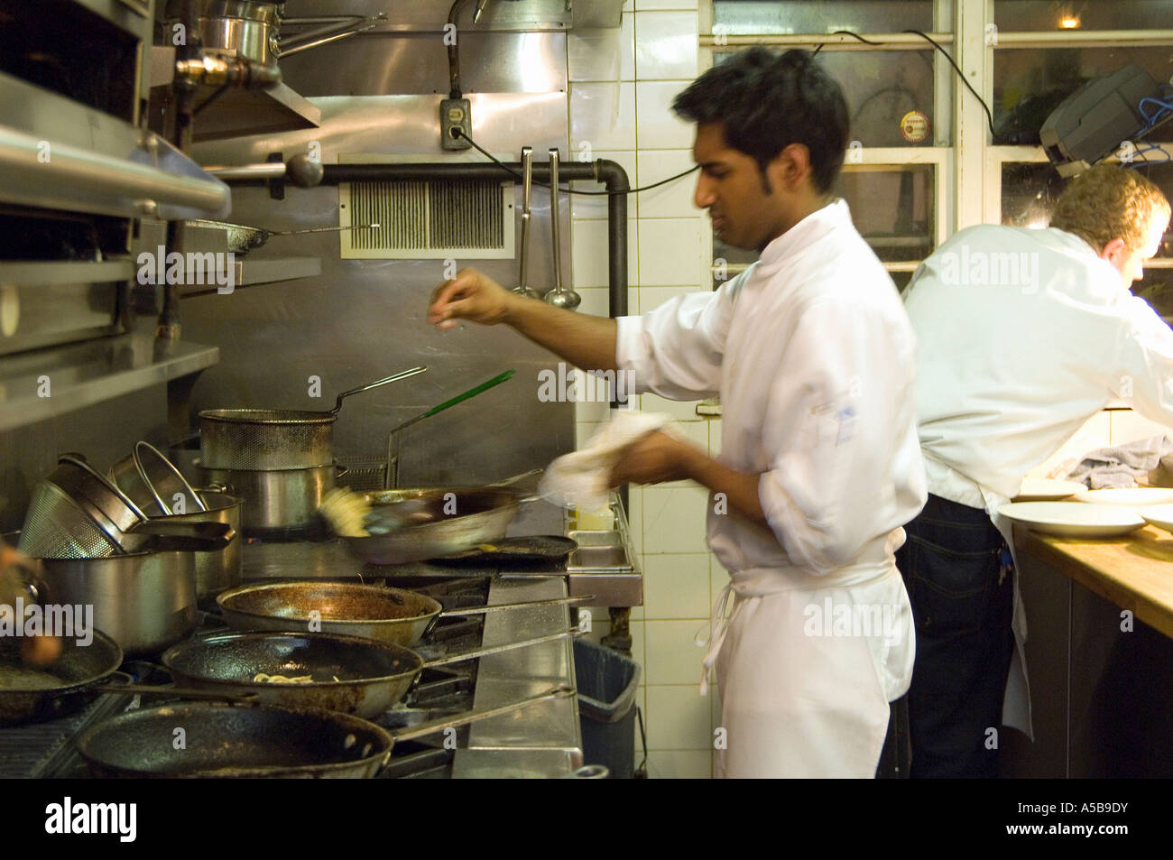 Busy Restaurant Kitchen Team Of Restaurant Kitchen Staff Busy At Work Stock Photo Royalty