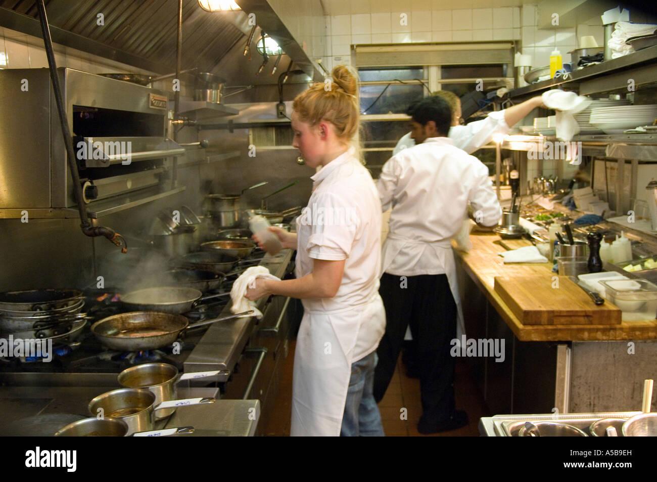 Busy Restaurant Kitchen team of restaurant kitchen staff busy at work stock photo, royalty