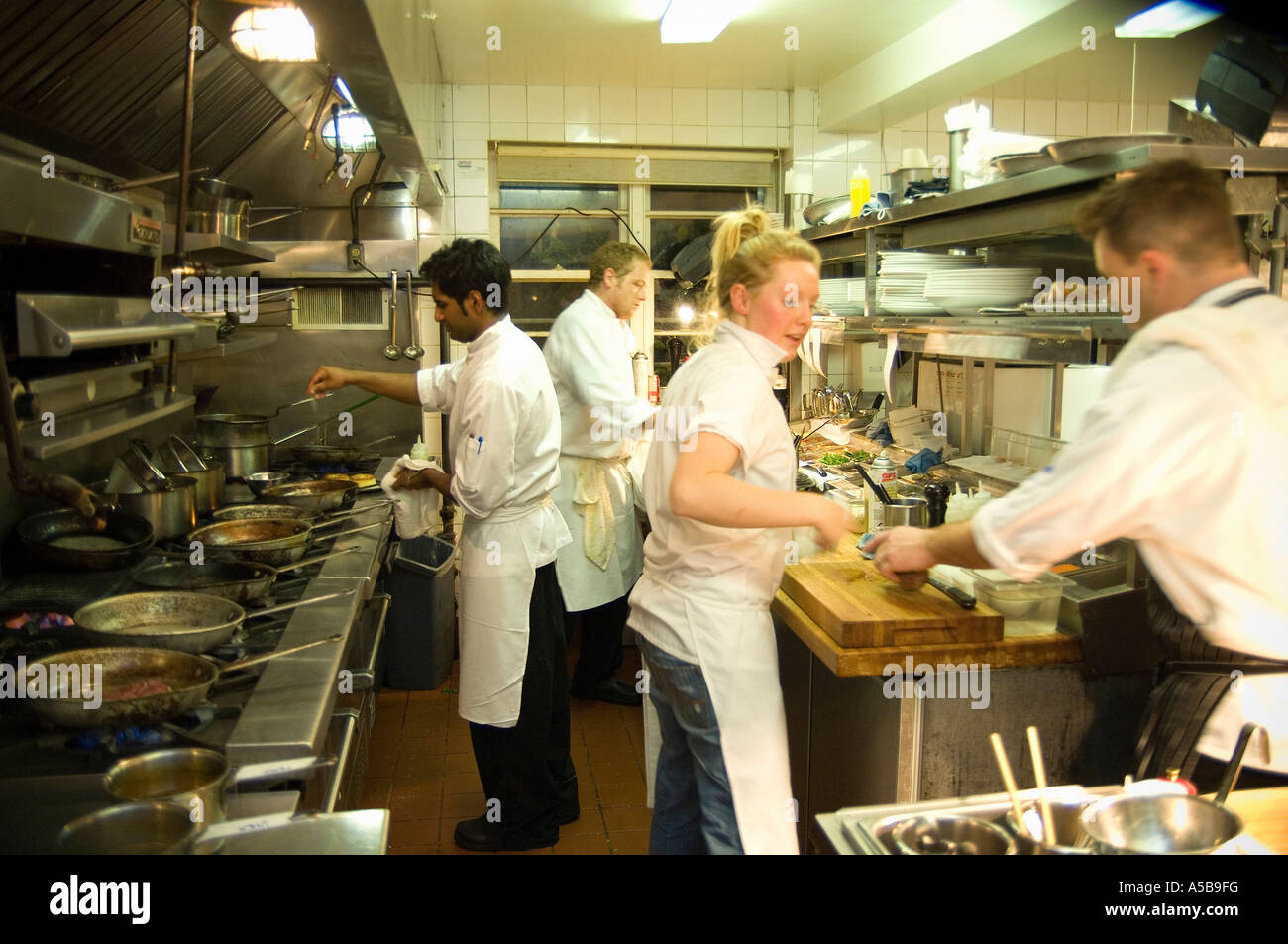 Team of restaurant kitchen staff busy at work stock photo for Kitchen 8 restaurant