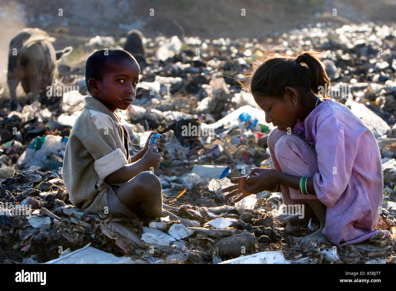Poor People Toys : Poor indian children playing with toy mobile phone whilst