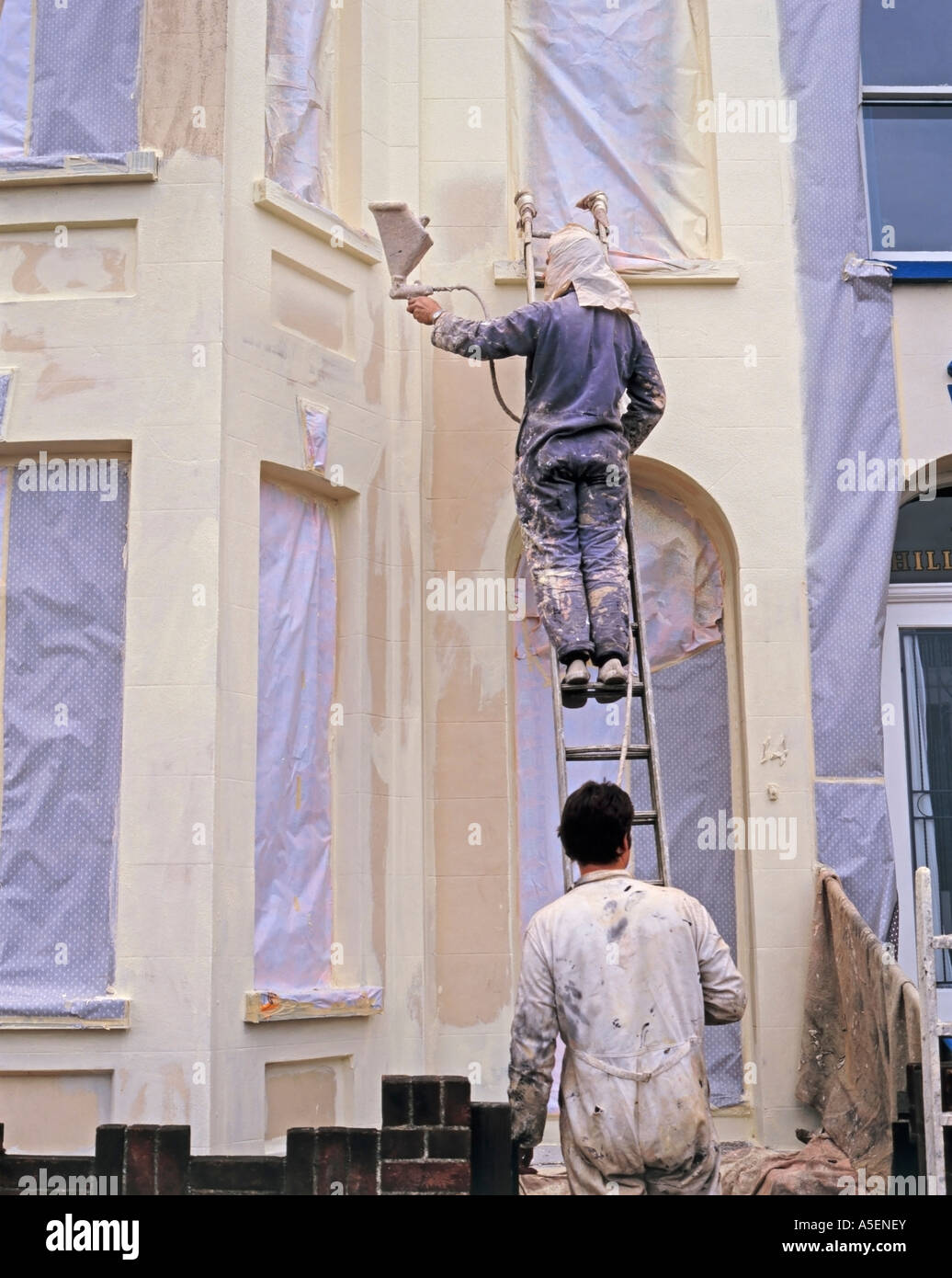 House exterior protection spray painting stock photo - Paint sprayer for house exterior ...