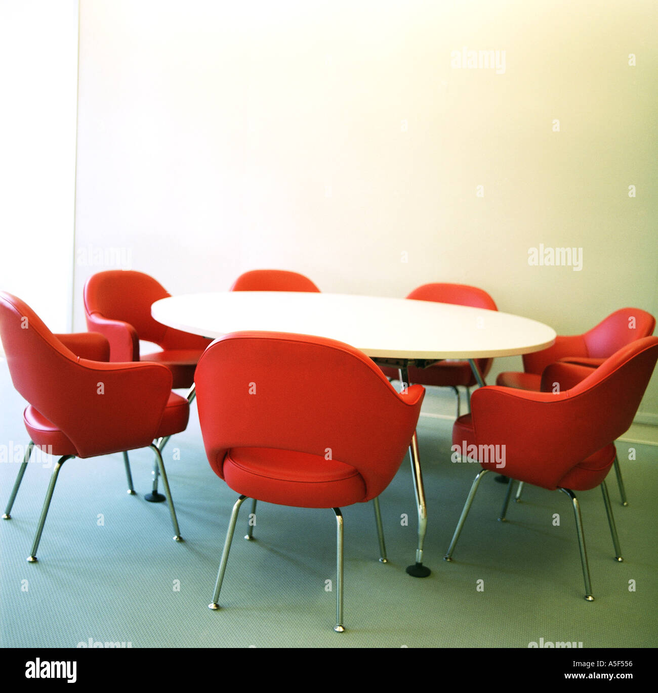 Red office chairs around a round table Stock Photo Royalty Free