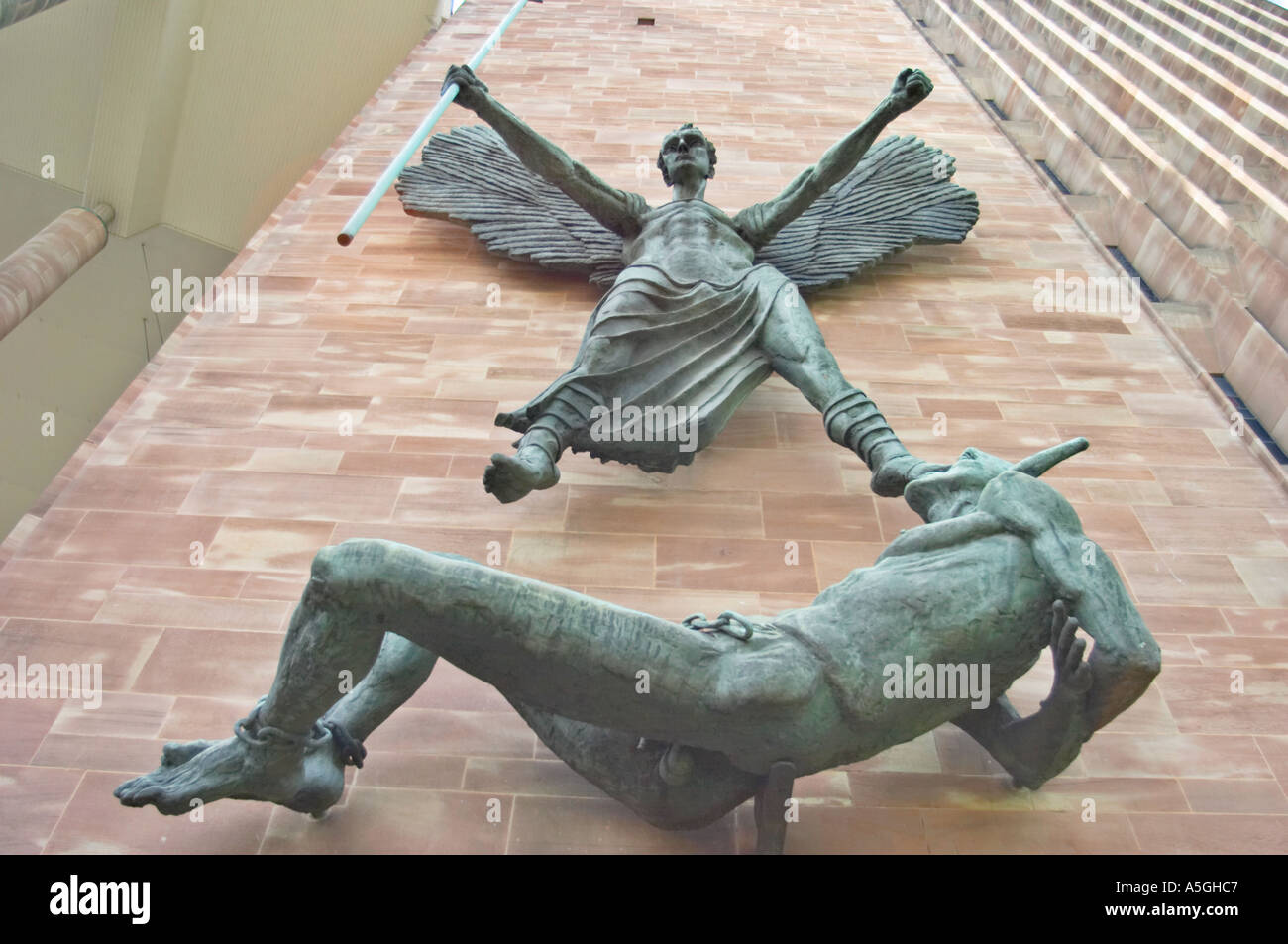 The Statue Of Saint Michael Defeating Satan On The Side Of The New Stock Photo Royalty Free