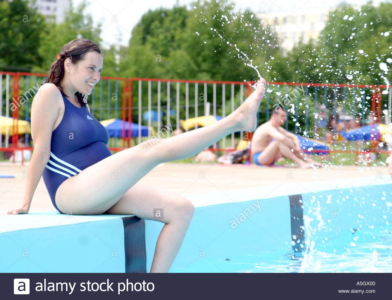 Pregnant Young Woman By The Swimming Pool Stock Photo Royalty Free Image 3693055 Alamy