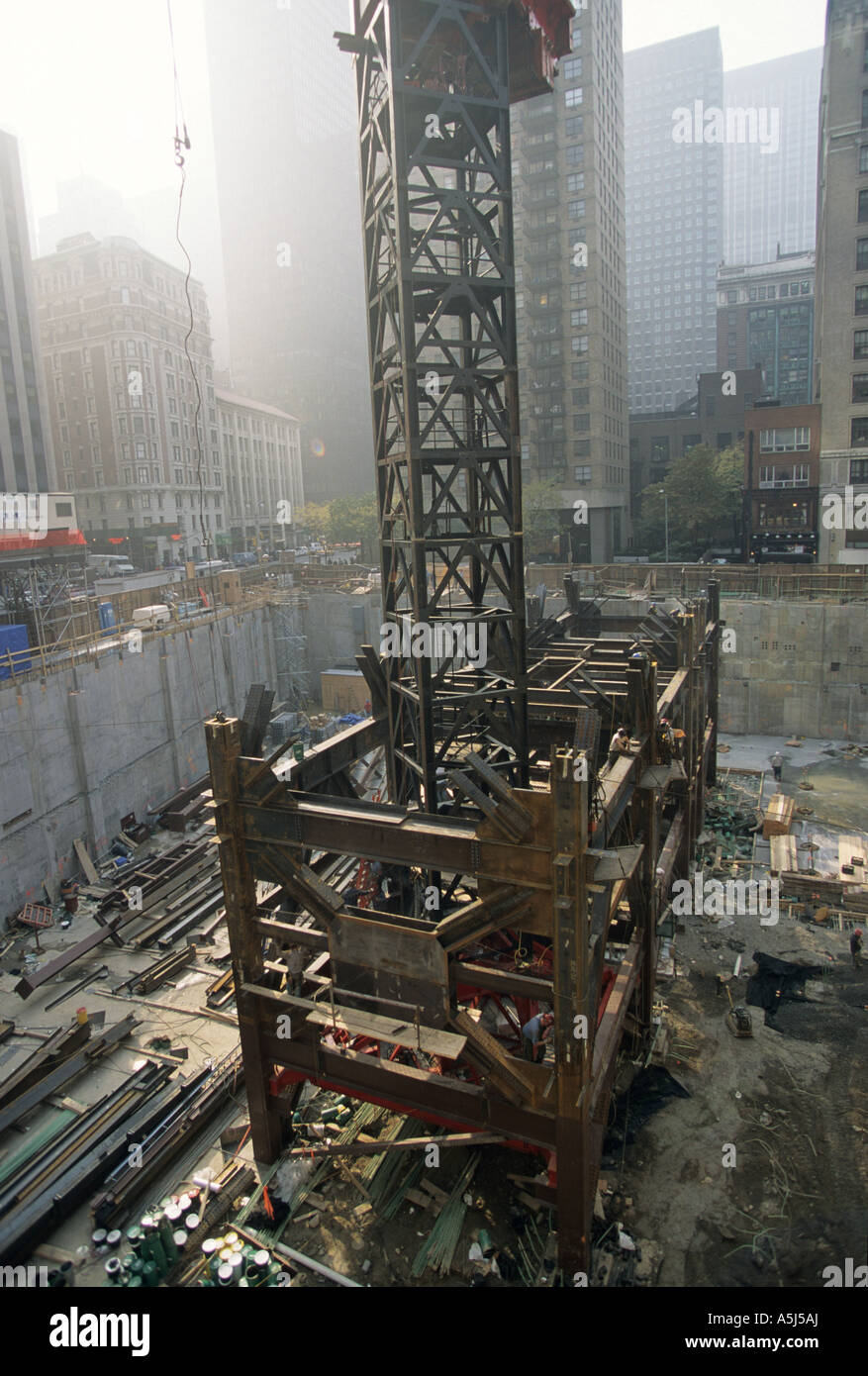 Tower Crane Ny : Steel core and crane tower on random house building at