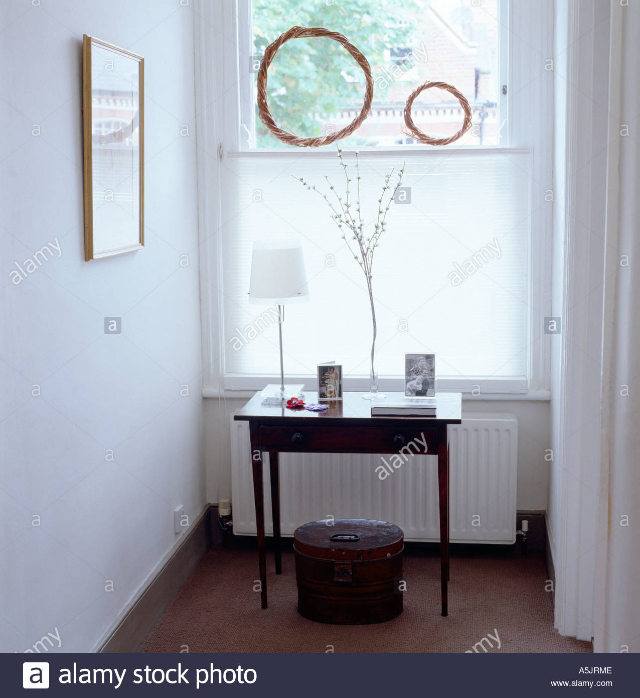 Upstairs hall landing with table, ornaments and window