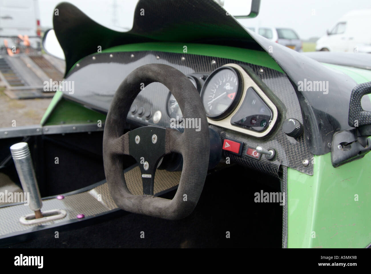 racing car interior sports car lightweight no luxury steering wheel stock photo royalty free. Black Bedroom Furniture Sets. Home Design Ideas