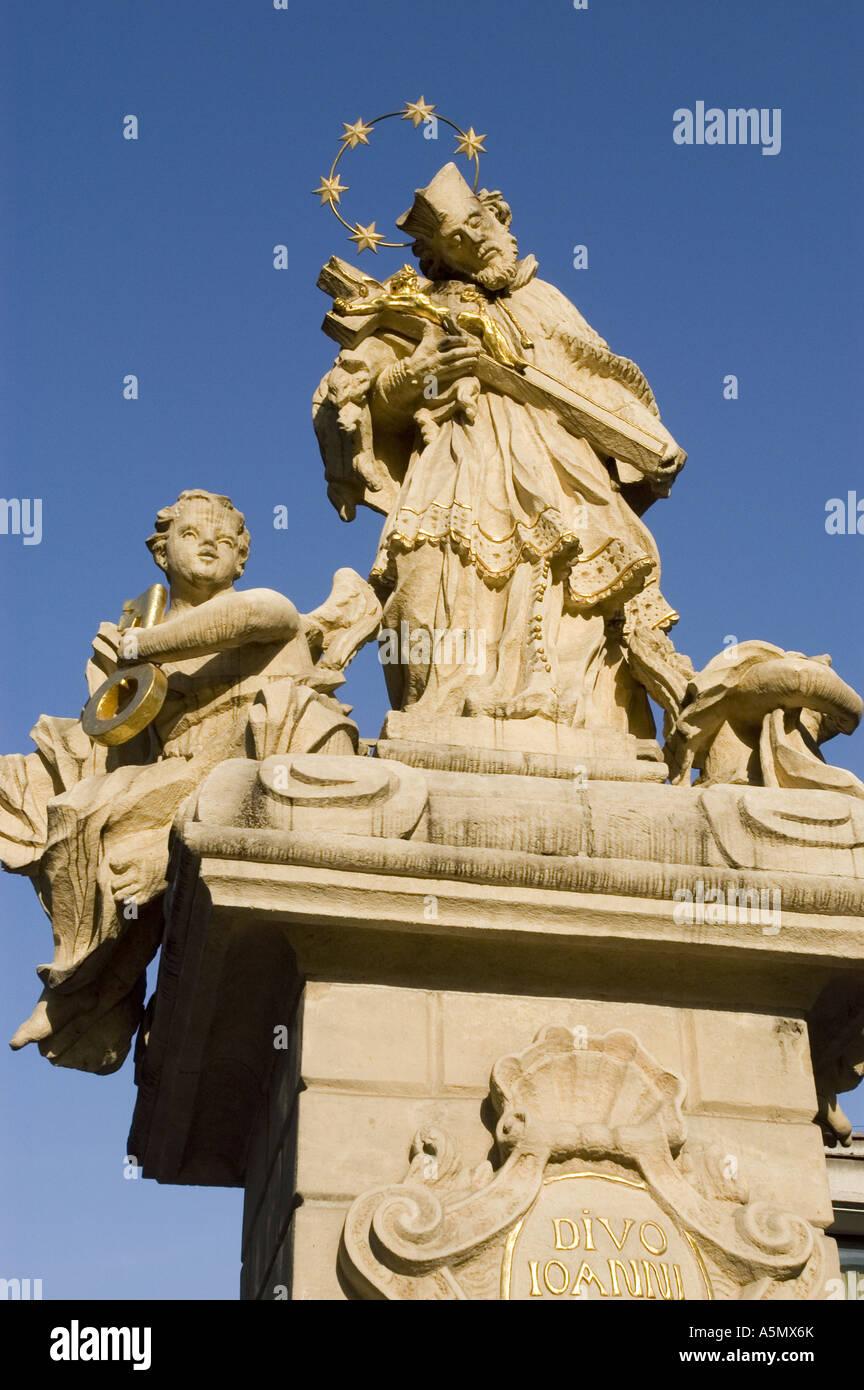 statue st john nepomuk religious figure holding cross with jesus