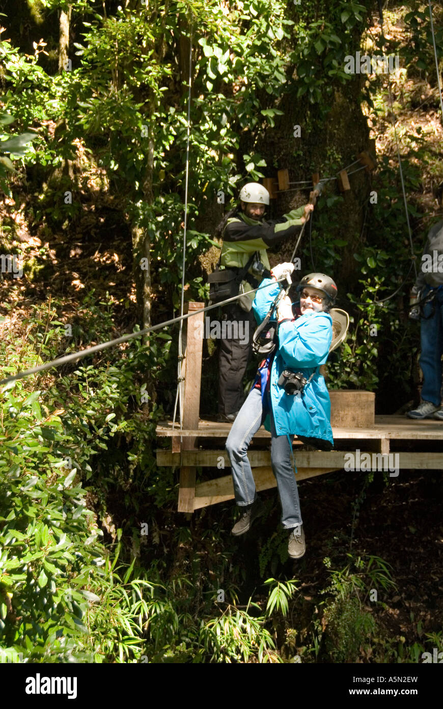 Chile Lake Country Canopying or ziplining adventure sport of sliding on a steel line through the canopy of the trees at Peulla & Chile Lake Country Canopying or ziplining adventure sport of ...