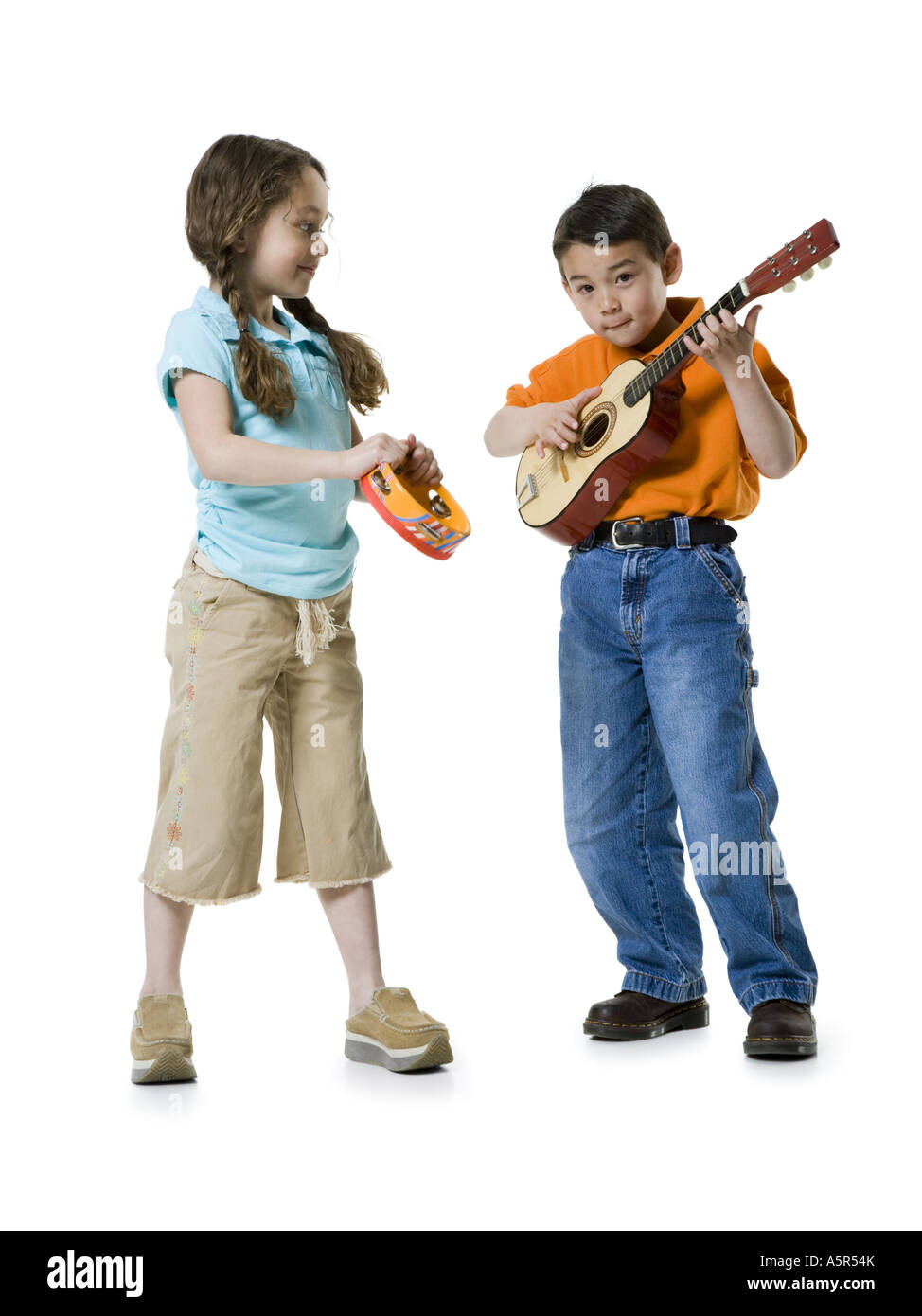 Portrait Of A Boy Playing The Guitar With Girl Standing Beside Him