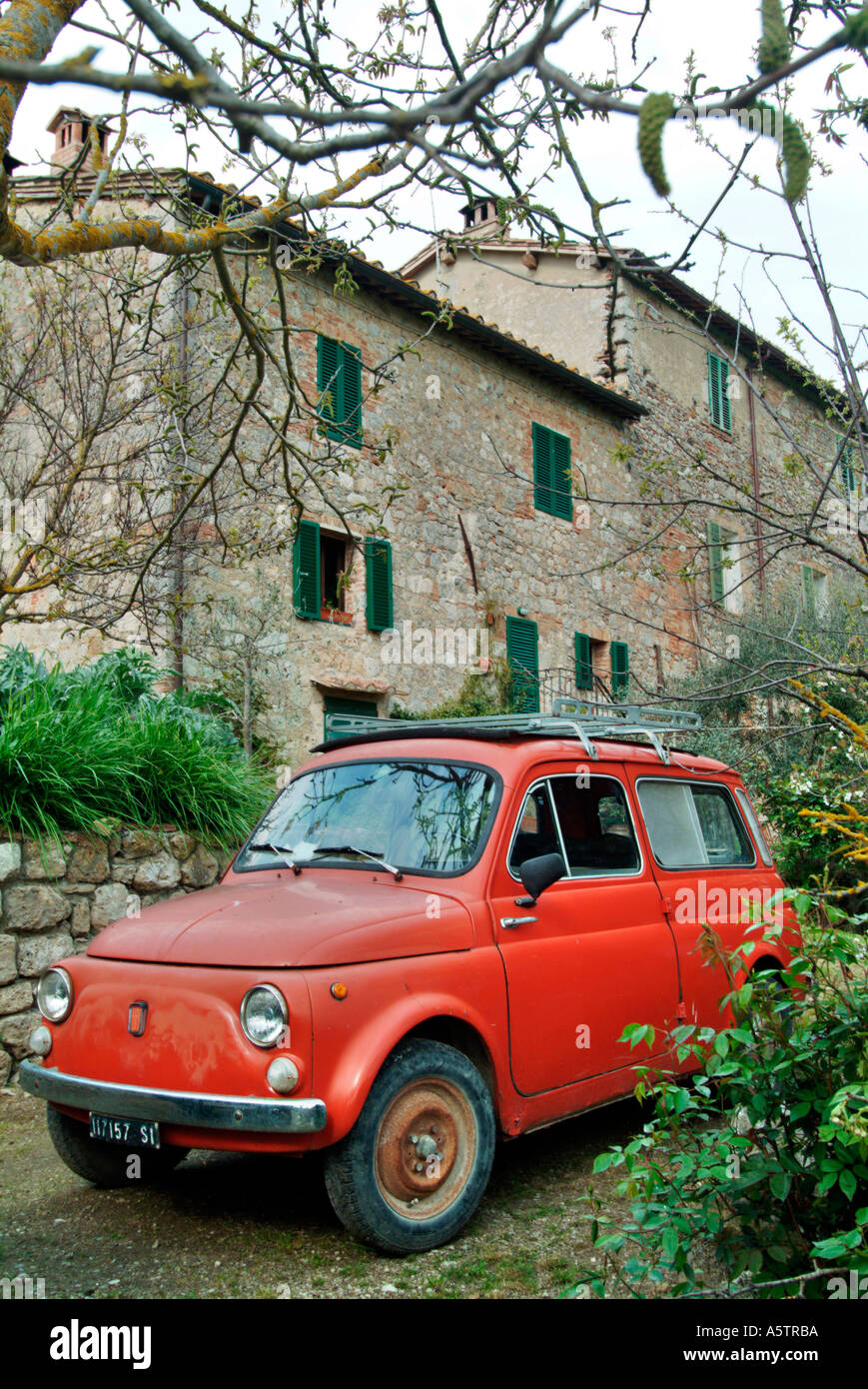 red oldtimer fiat 500 in front of an old house in tuscany. Black Bedroom Furniture Sets. Home Design Ideas