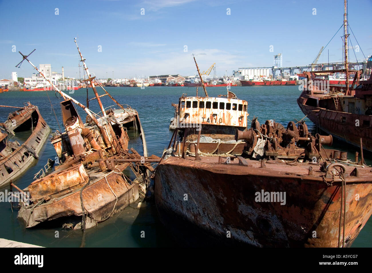 Junk fishing boats rust in the water at Puerto Faro, Mar ...