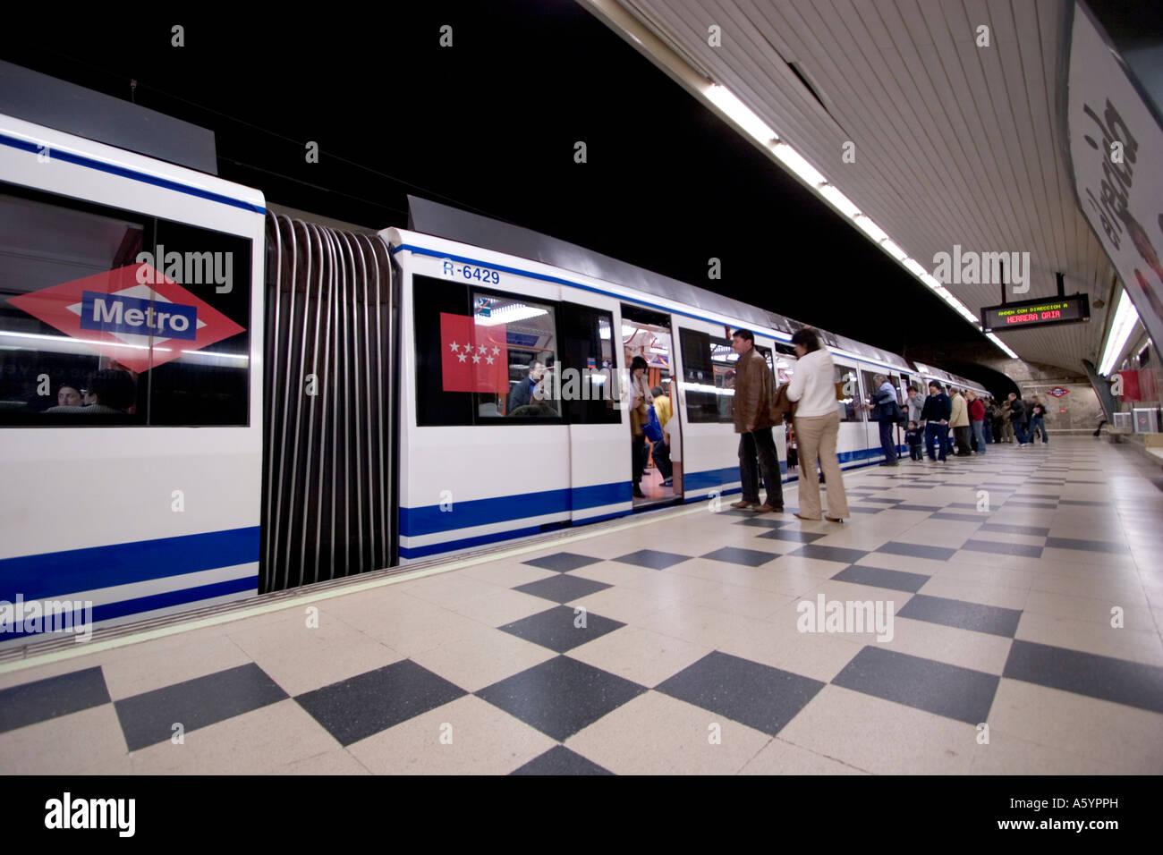 Madrid metro underground tube network train coming into station ...